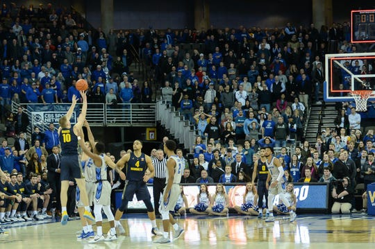 Marquette forward Sam Hauser gets off his three-pointer just before the buzzer that sends the Golden Eagles' game against Creighton into overtime Wednesday night.