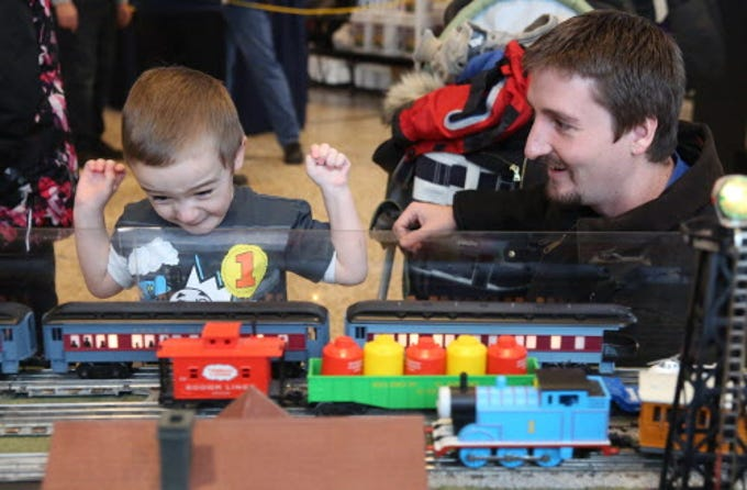 Nolan Bindl, left,  got real excited everytime the train went by as he watched with his dad Ben Bindl at the 2015 train show.