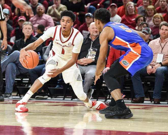 Arkansas' Isaiah Joe is guarded by Florida's KeVaughn Allen on Wednesday night at Walton Arena.