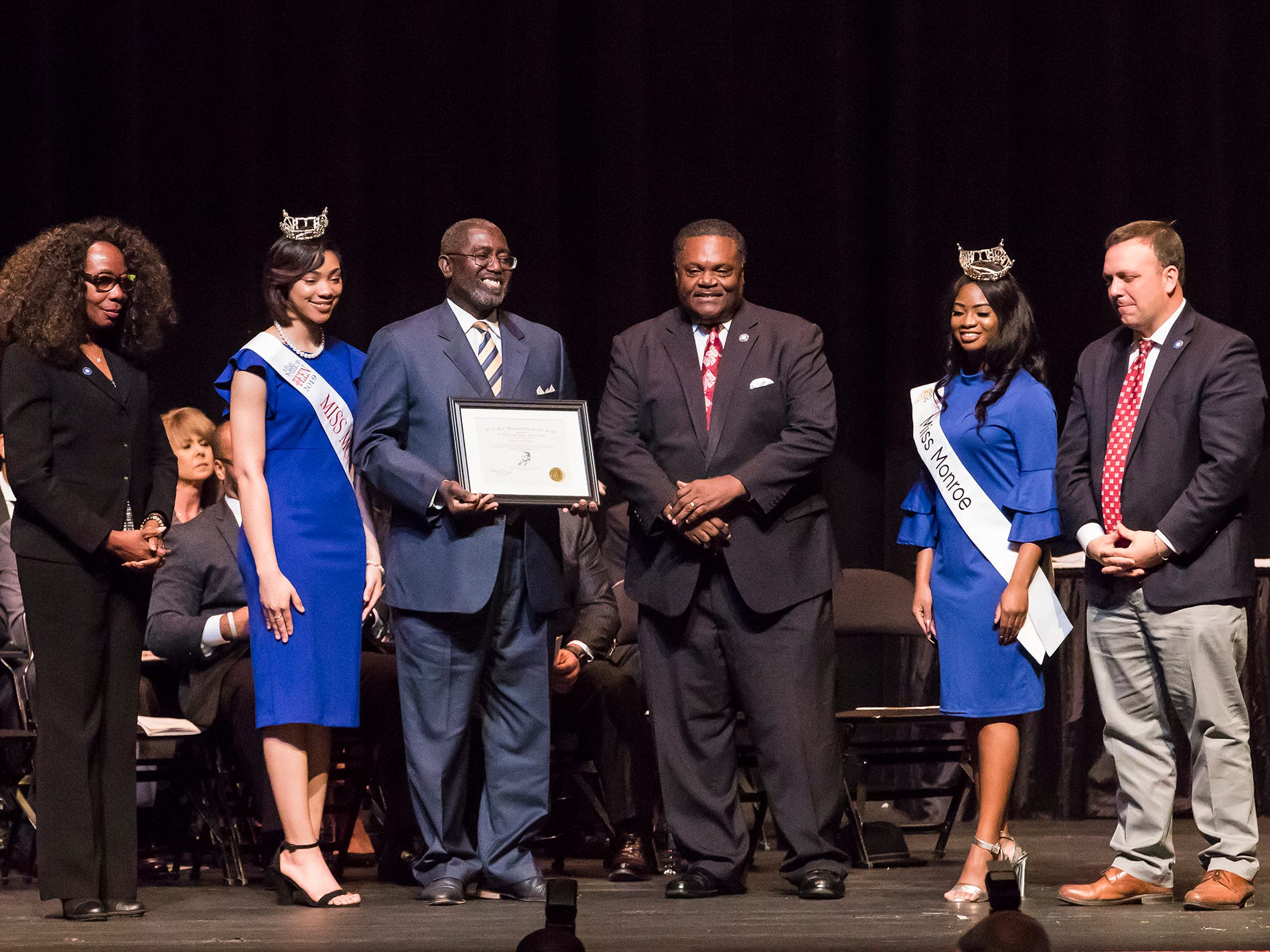 "Judge Robert Johnson was recognized with the  W.L. ""Jack"" Howard Public Service Award. It was presented by City Council Vice-Chair Juanita Woods, Miss Monroe's Outstanding Teen Heaven Britton, Mayor Jamie Mayo, Miss Monroe Grace Powell and City Councilman Michael Echols."