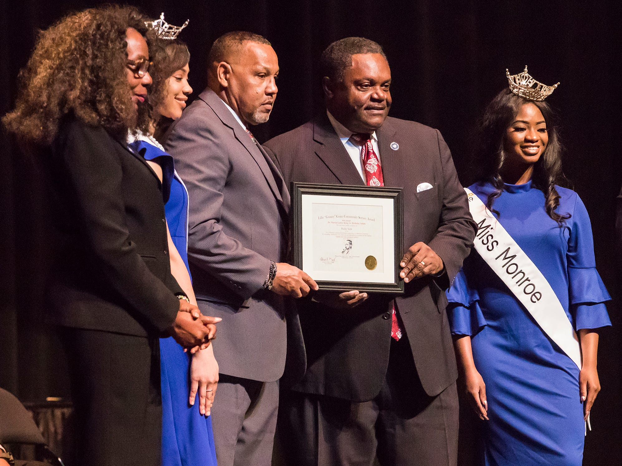 "Ricky York was recognized with the Lillie ""Granny"" Goins Community Service Award. It was presented by City Council Vice-Chair Juanita Woods, Miss Monroe's Outstanding Teen Heaven Britton, Mayor Jamie Mayo, Miss Monroe Grace Powell and City Councilman Michael Echols."
