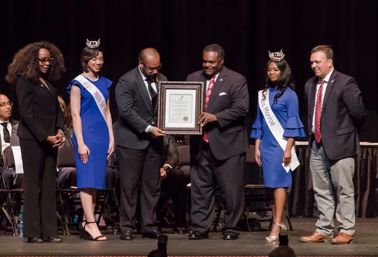 Grambling State University Football Coach Broderick Fobbs was recognized with the Dr. Martin Luther King Trailblazer Award. It was presented by City Council Vice-Chair Juanita Woods, Miss Monroe's Outstanding Teen Heaven Britton, Mayor Jamie Mayo, Miss Monroe Grace Powell and City Councilman Michael Echols.