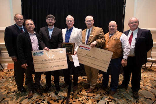 Lake Providence farmer Robbie Howard, center, was presented the Outstanding Master Farmer Award on Jan. 10, 2019. He is pictured with, from left, LSU Vice President for Agriculture Bill Richardson; John Pitre, of the Natural Resources Conservation Service; Eric Bergeron, of Gowan; Stephen Austin, of the Louisiana Land Bank; Louisiana Department of Agriculture and Forestry Commissioner Mike Strain; and David Daigle, president of the Louisiana Association of Conservation Districts.