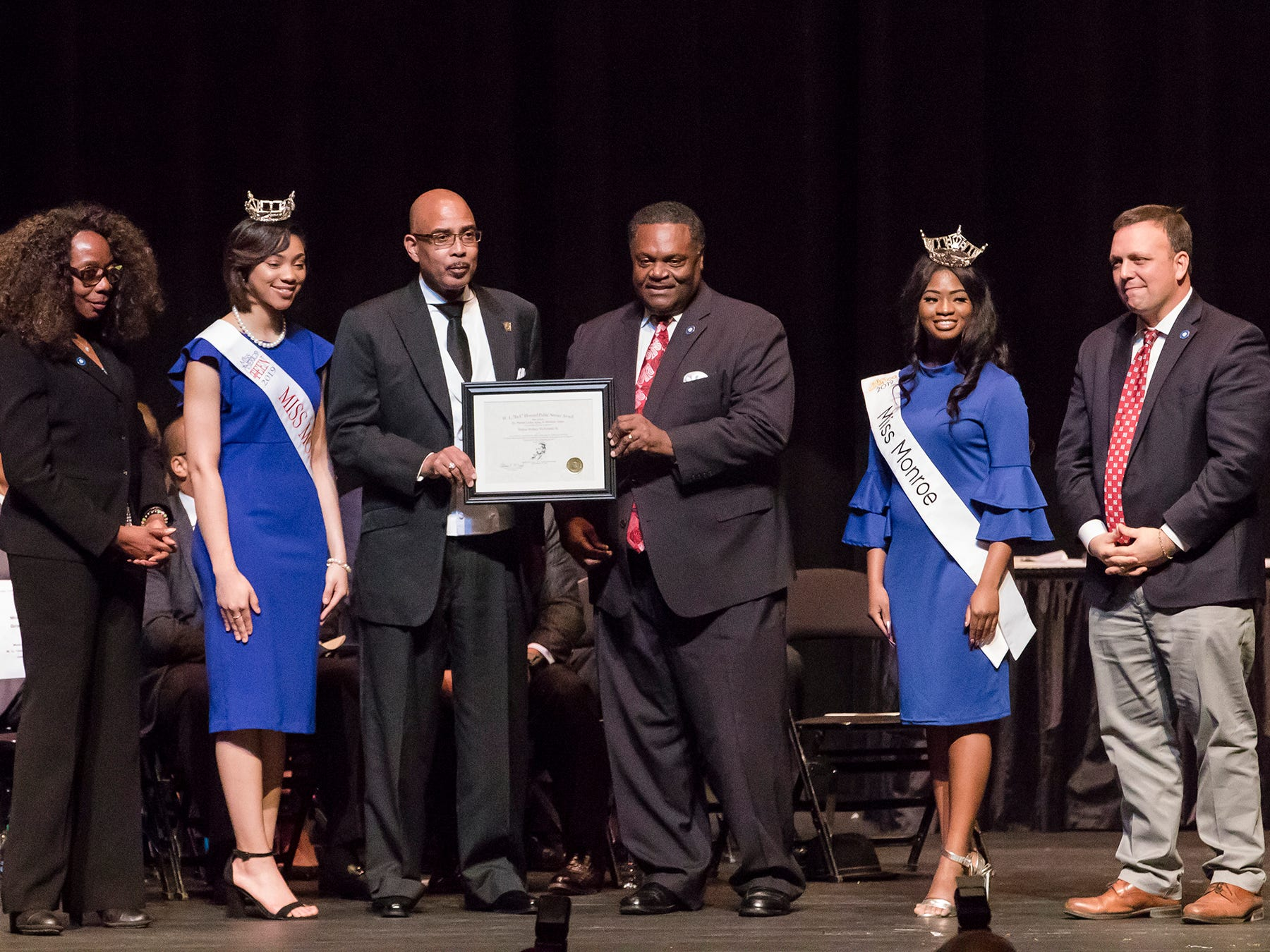 "Rodney McFarland was recognized with the W.L. ""Jack"" Howard Public Service Award. It was presented by City Council Vice-Chair Juanita Woods, Miss Monroe's Outstanding Teen Heaven Britton, Mayor Jamie Mayo, Miss Monroe Grace Powell and City Councilman Michael Echols."