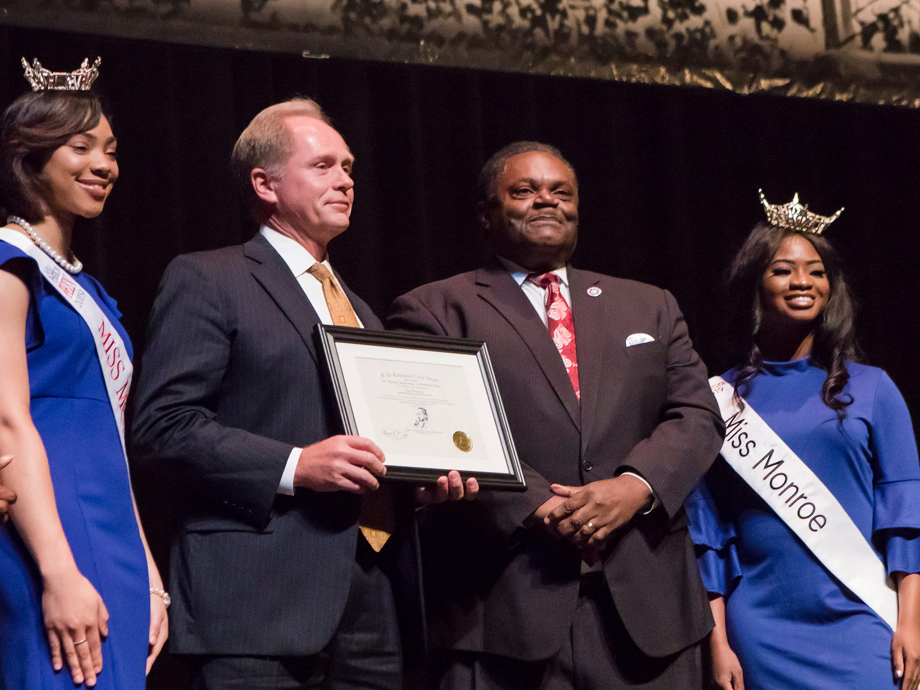 Tom Pearson was recognized with the B.D. Robinson Unity Award. It was presented by City Council Vice-Chair Juanita Woods, Miss Monroe's Outstanding Teen Heaven Britton, Mayor Jamie Mayo, Miss Monroe Grace Powell and City Councilman Michael Echols.