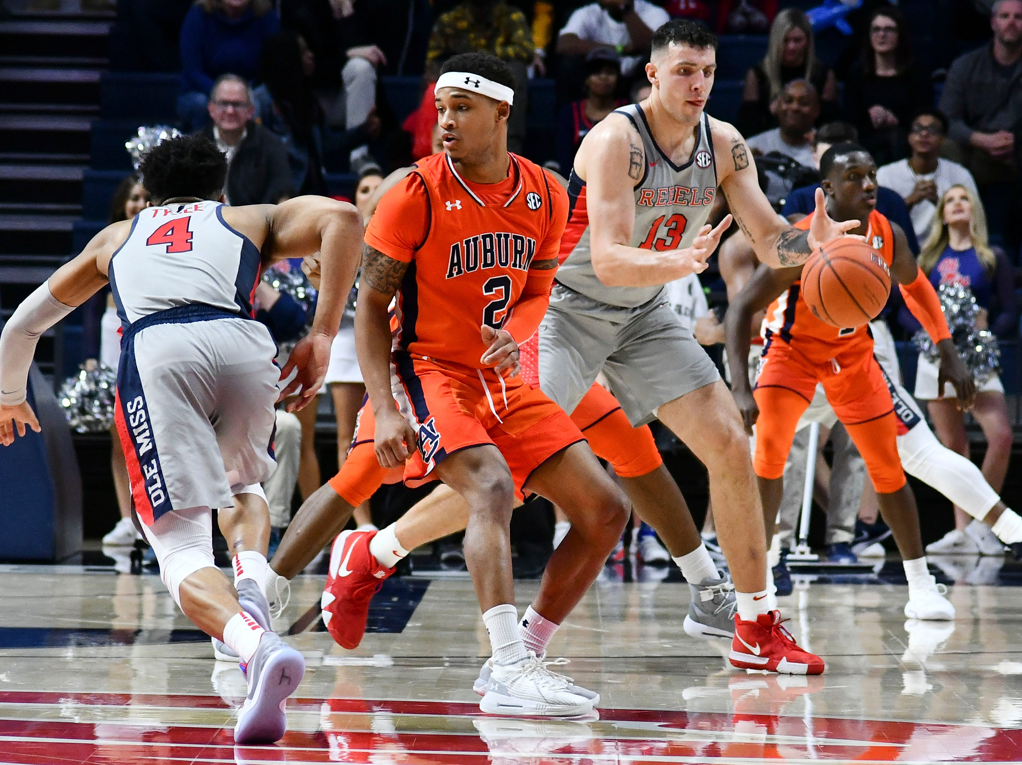 Jan 9, 2019; Oxford, MS, USA; Mississippi Rebels center Dominik Olejniczak (13) catches a pass from guard Breein Tyree (4) past Auburn Tigers guard Bryce Brown (2) during the first quarter at The Pavilion at Ole Miss. Mandatory Credit: Matt Bush-USA TODAY Sports