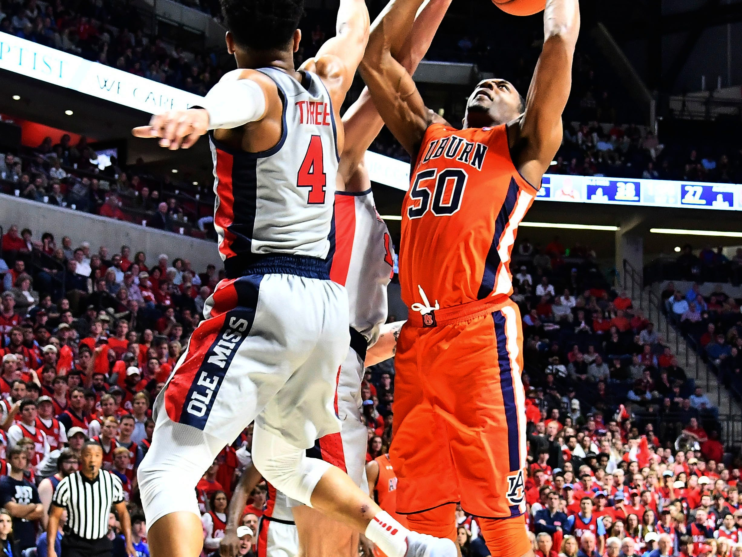 Jan 9, 2019; Oxford, MS, USA; Auburn Tigers center Austin Wiley (50) shoots defended by Mississippi Rebels guard Breein Tyree (4) during the first quarter at The Pavilion at Ole Miss. Mandatory Credit: Matt Bush-USA TODAY Sports