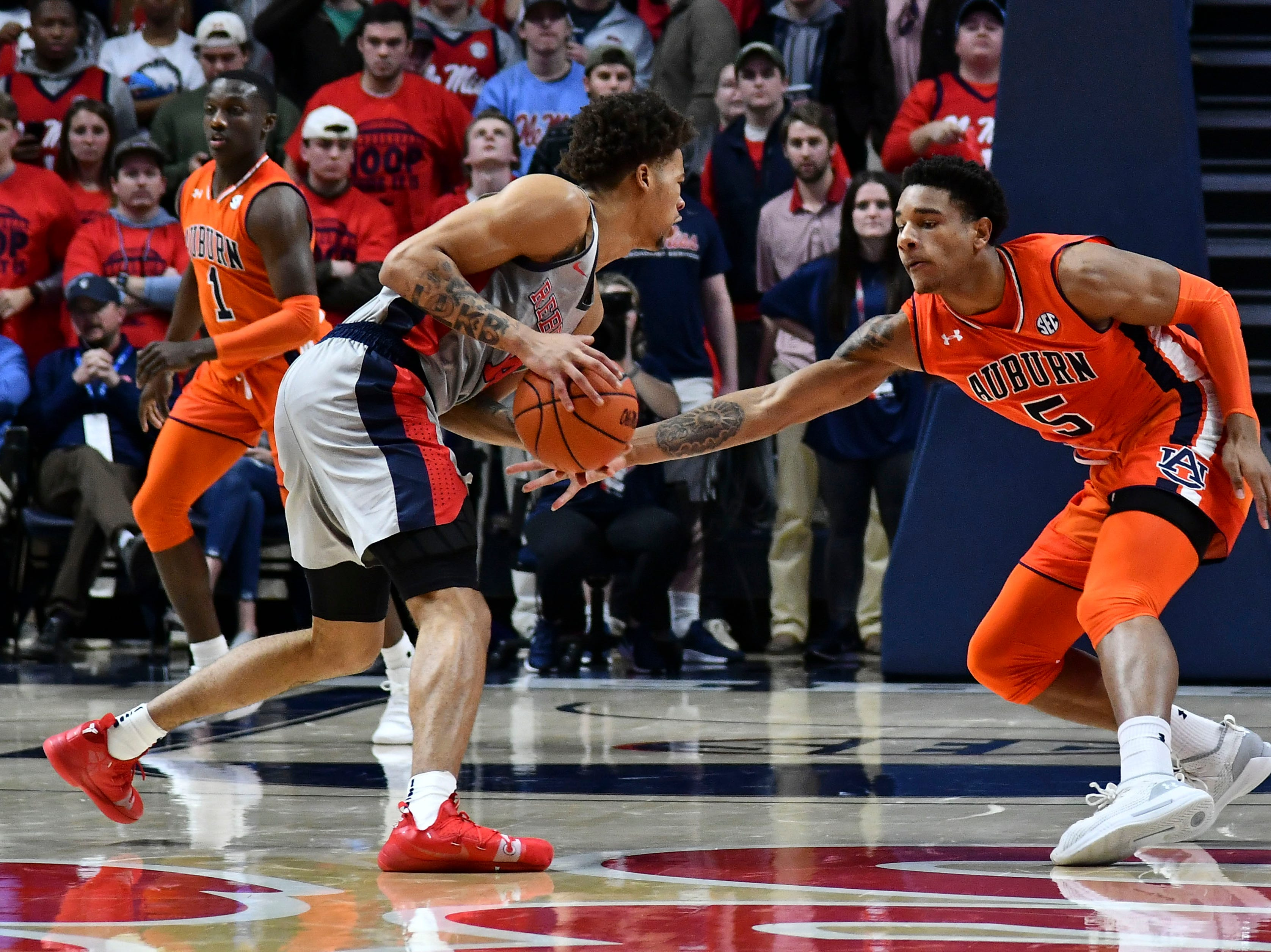 Jan 9, 2019; Oxford, MS, USA; Mississippi Rebels forward KJ Buffen (14) handles the ball defended by Auburn Tigers forward Chuma Okeke (5) during the first quarter at The Pavilion at Ole Miss. Mandatory Credit: Matt Bush-USA TODAY Sports