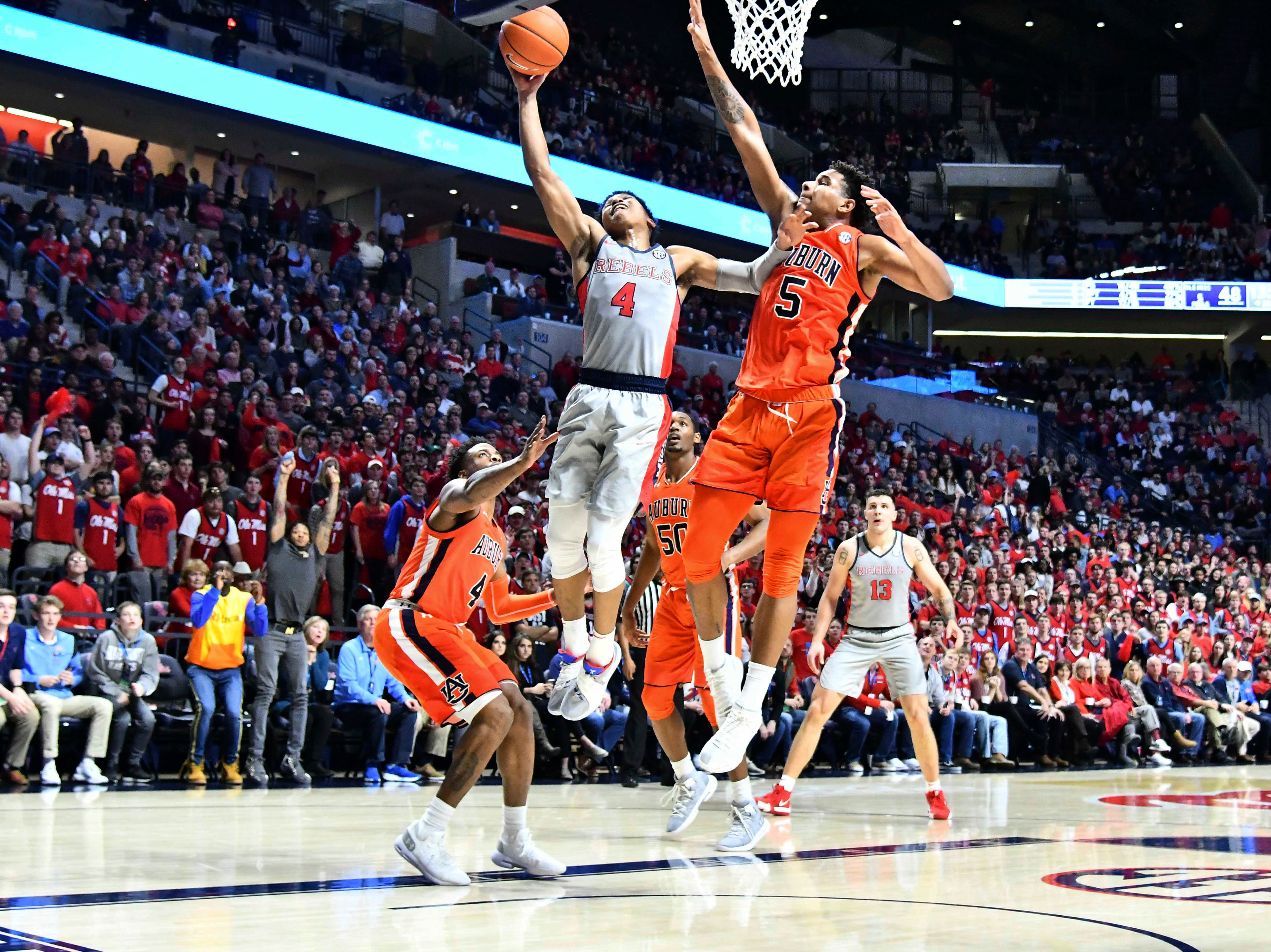 Jan 9, 2019; Oxford, MS, USA; Mississippi Rebels guard Breein Tyree (4) goes up for a shot defended by Auburn Tigers forward Chuma Okeke (5) during the second half at The Pavilion at Ole Miss. Mandatory Credit: Matt Bush-USA TODAY Sports