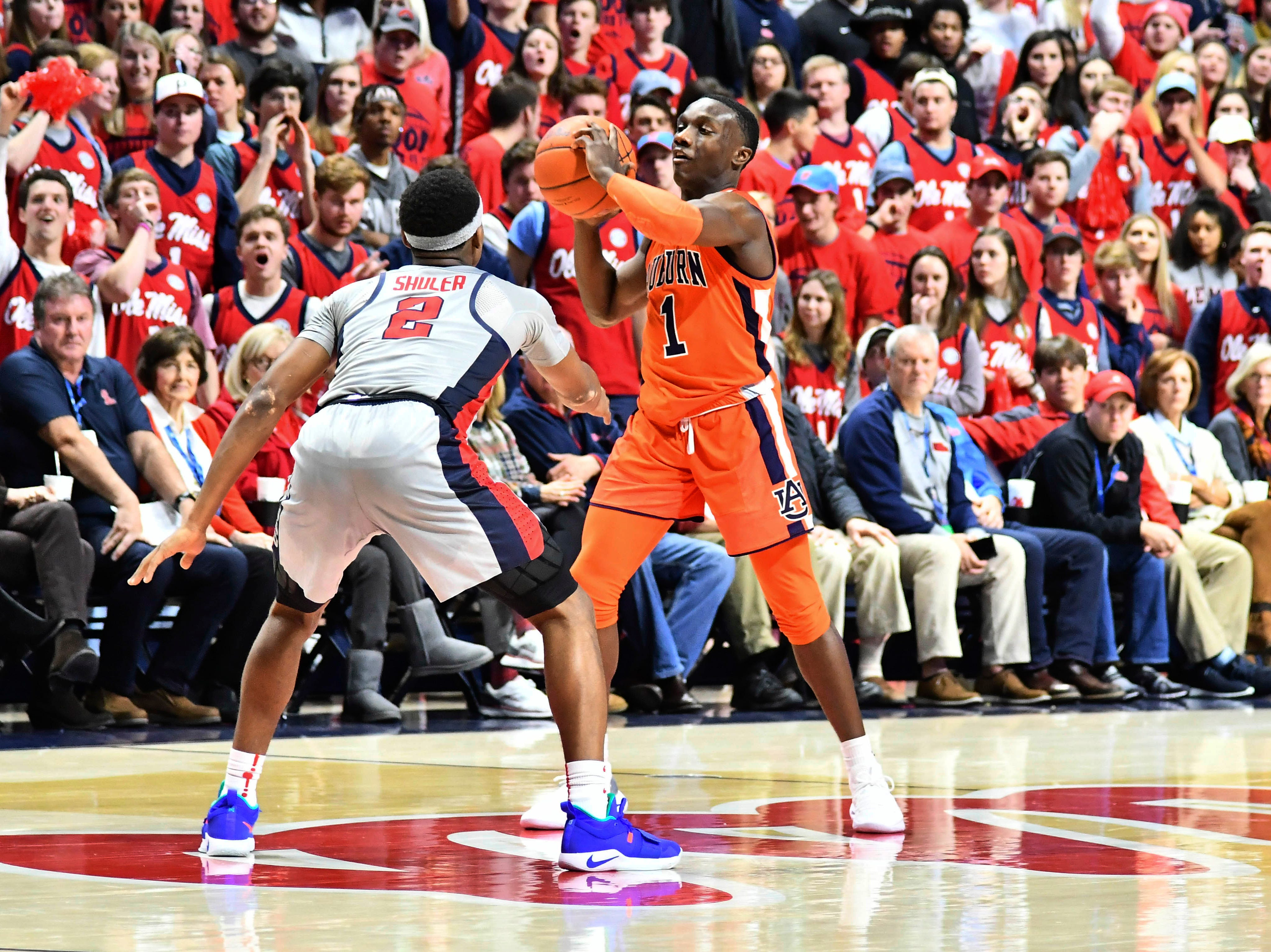 Jan 9, 2019; Oxford, MS, USA; Auburn Tigers guard Jared Harper (1) holds the ball defended by Mississippi Rebels guard Devontae Shuler (2) at The Pavilion at Ole Miss. Mandatory Credit: Matt Bush-USA TODAY Sports