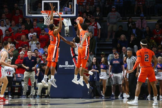 Auburn's Chuma Okeke (5) and Austin Wiley (50) try to block an Ole Miss shot on Jan. 9, 2019, in Oxford, Miss.