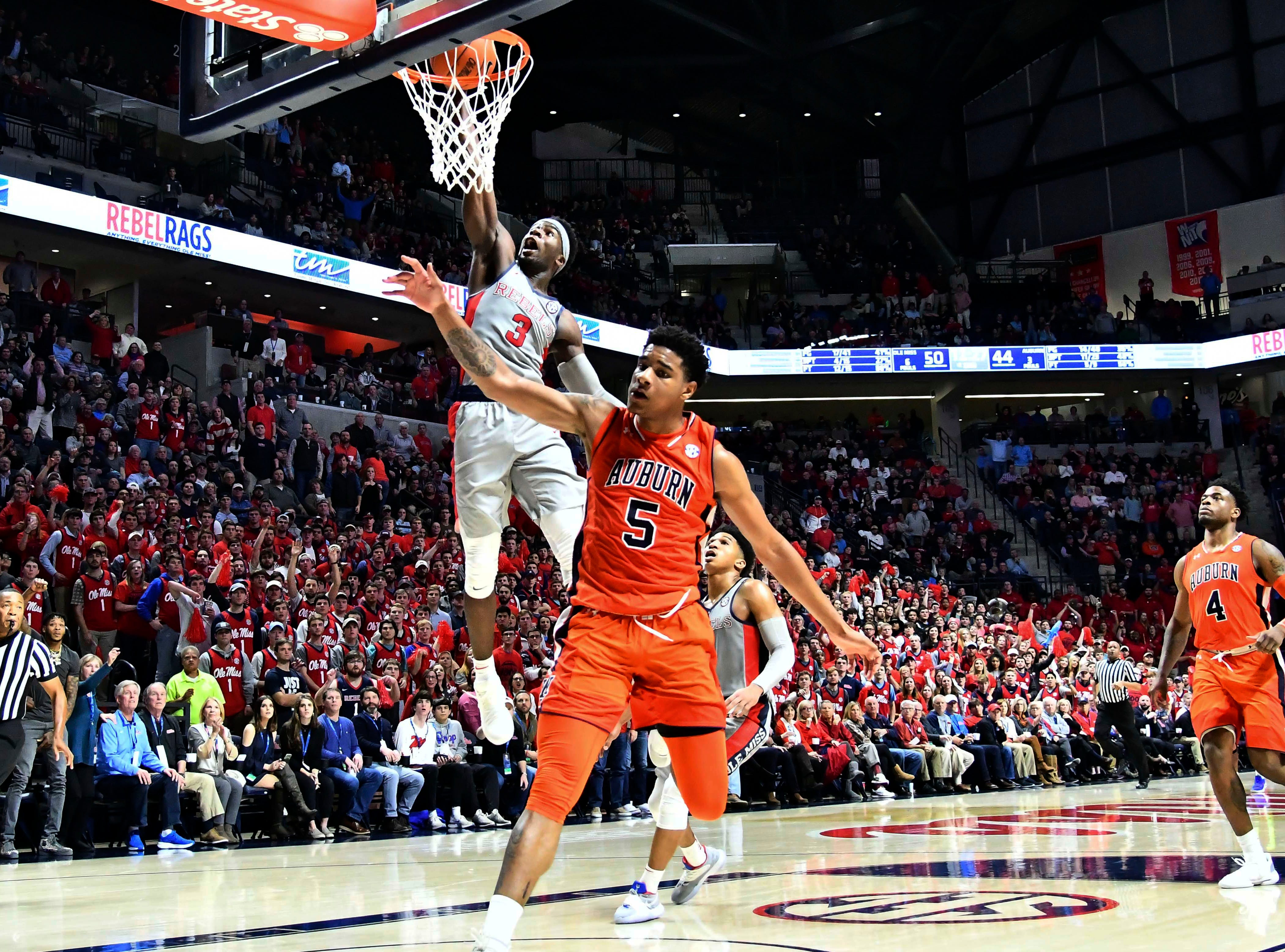 Jan 9, 2019; Oxford, MS, USA; Mississippi Rebels guard Terence Davis (3) goes up for a dunk defended by Auburn Tigers forward Chuma Okeke (5) during the second half at The Pavilion at Ole Miss. Mandatory Credit: Matt Bush-USA TODAY Sports