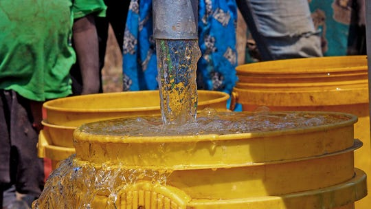 Water flows from a well in Kaole Village, Zambia.