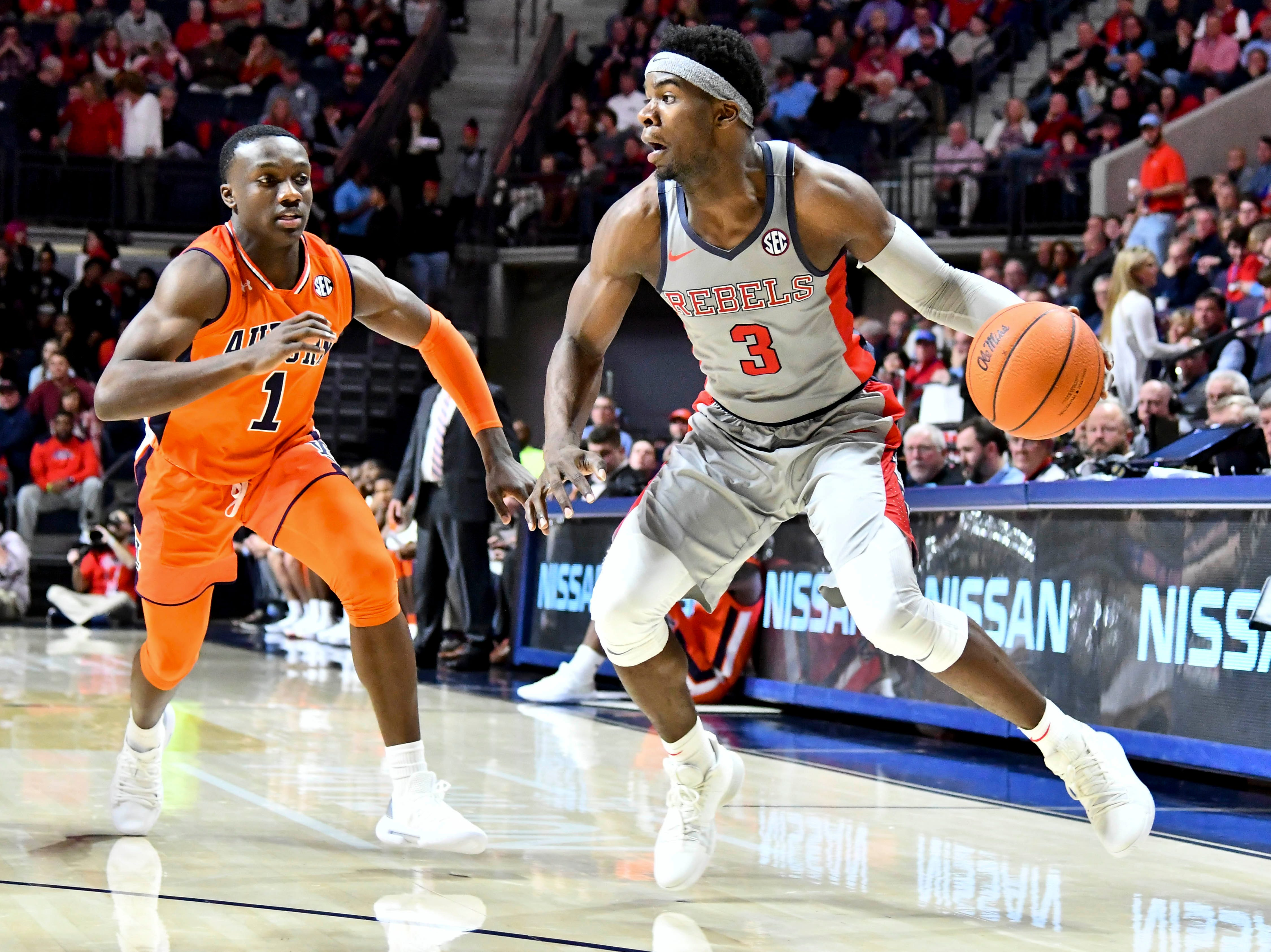 Jan 9, 2019; Oxford, MS, USA; Mississippi Rebels guard Terence Davis (3) handles the ball defended by Auburn Tigers guard Jared Harper (1) during the second half at The Pavilion at Ole Miss. Mandatory Credit: Matt Bush-USA TODAY Sports