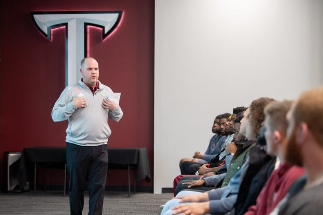 New Troy coach Chip Lindsey speaks to the Trojans at his first team meeting Thursday.