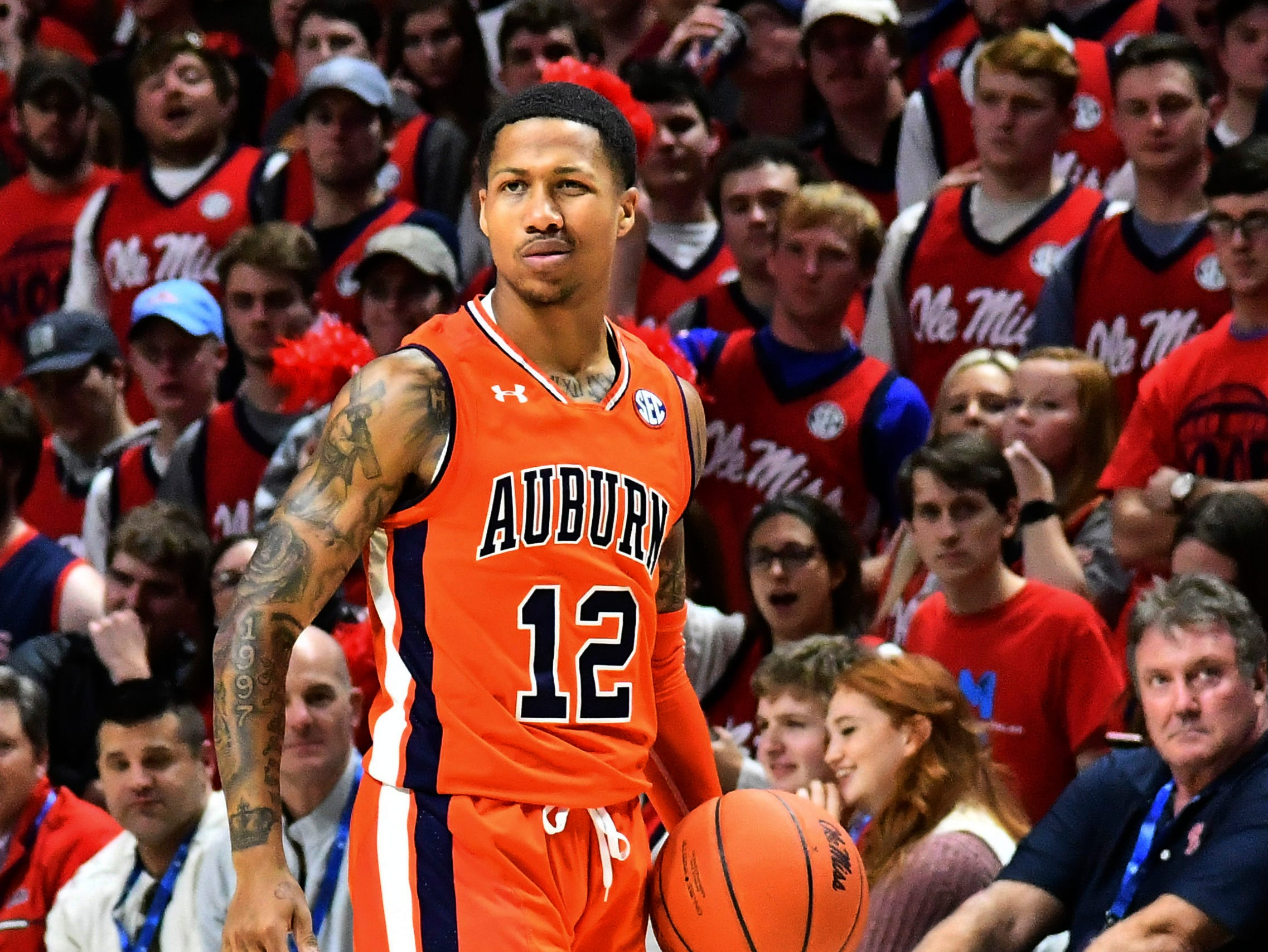 Jan 9, 2019; Oxford, MS, USA; Auburn Tigers guard J'Von McCormick (12) handles the ball against the Mississippi Rebels during the second half at The Pavilion at Ole Miss. Mandatory Credit: Matt Bush-USA TODAY Sports