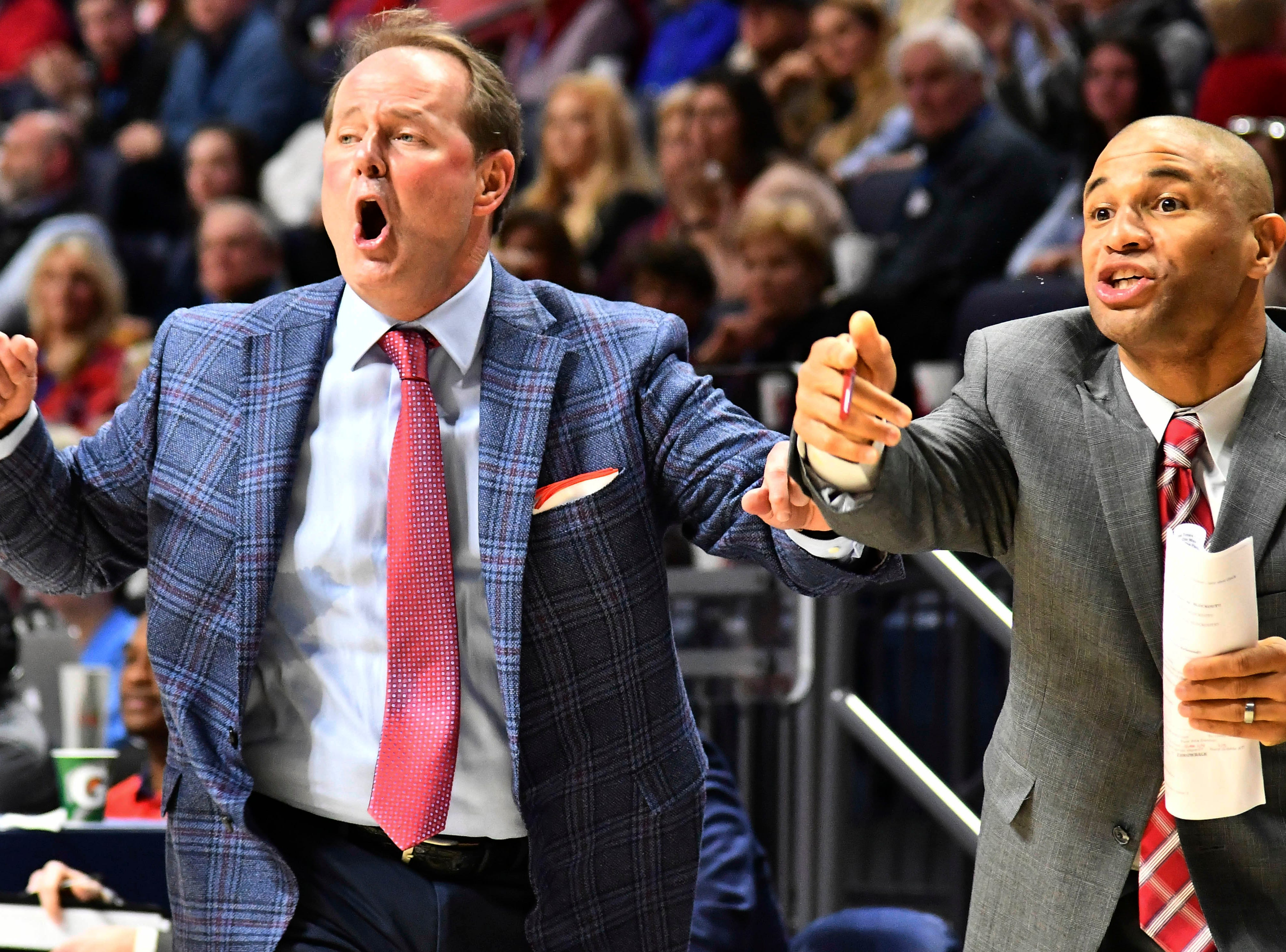 Jan 9, 2019; Oxford, MS, USA; Mississippi Rebels head coach Kermit Davis reacts after a play during the first quarter of the game against the Auburn Tigers at The Pavilion at Ole Miss. Mandatory Credit: Matt Bush-USA TODAY Sports