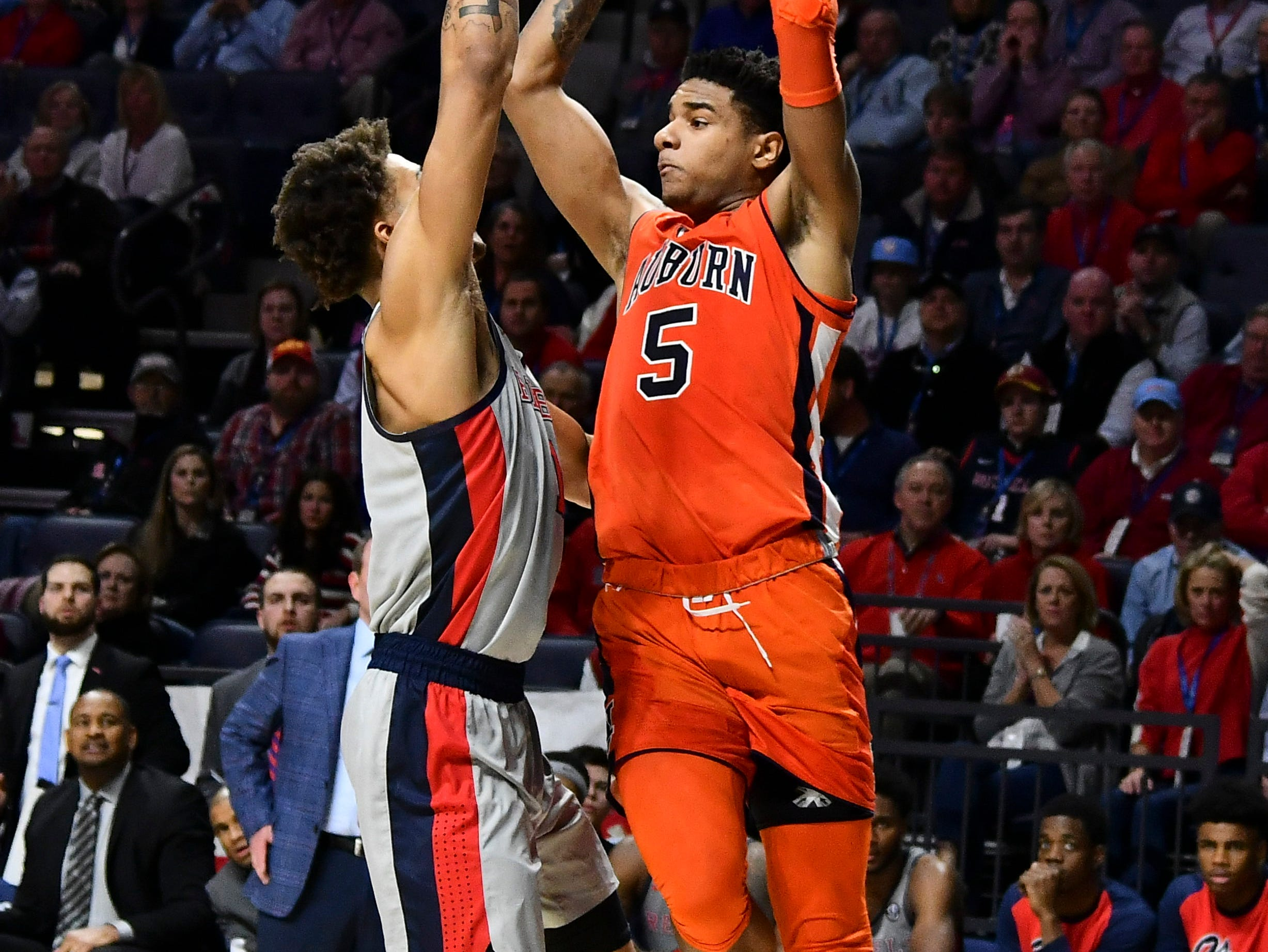Jan 9, 2019; Oxford, MS, USA; Auburn Tigers forward Chuma Okeke (5) goes up for a pass defended by Mississippi Rebels forward KJ Buffen (14) during the first quater at The Pavilion at Ole Miss. Mandatory Credit: Matt Bush-USA TODAY Sports