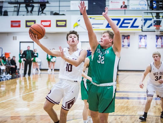 Wes-Del's Eric Harlan shoots past Yorktown's defense during the Delaware County Basketball Tournament at Delta High School Tuesday, Jan. 8, 2019.
