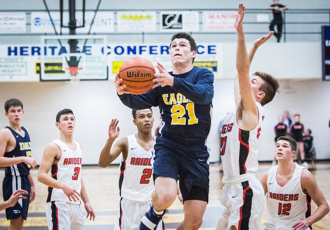 Delta's Conner Bedwell, shown here going up for a layup during the county tournament, has become a key player off the bench for the Eagles this season.