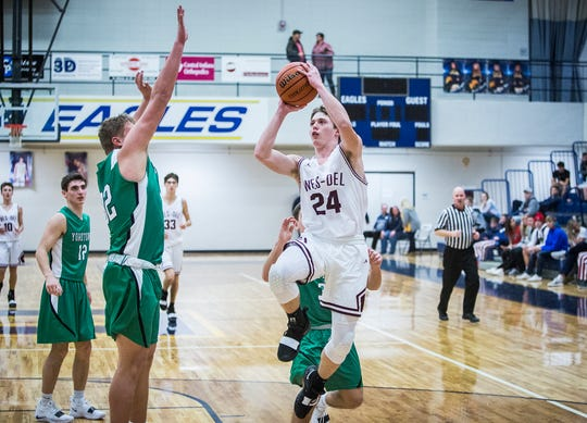 FILE -- Wes-Del's Caeden McClaughry goes up for a shot against Yorktown during the Delaware County Basketball Tournament at Delta High School Tuesday, Jan. 8, 2019. McClaughry led the Warriors with 12.8 points per game last season.