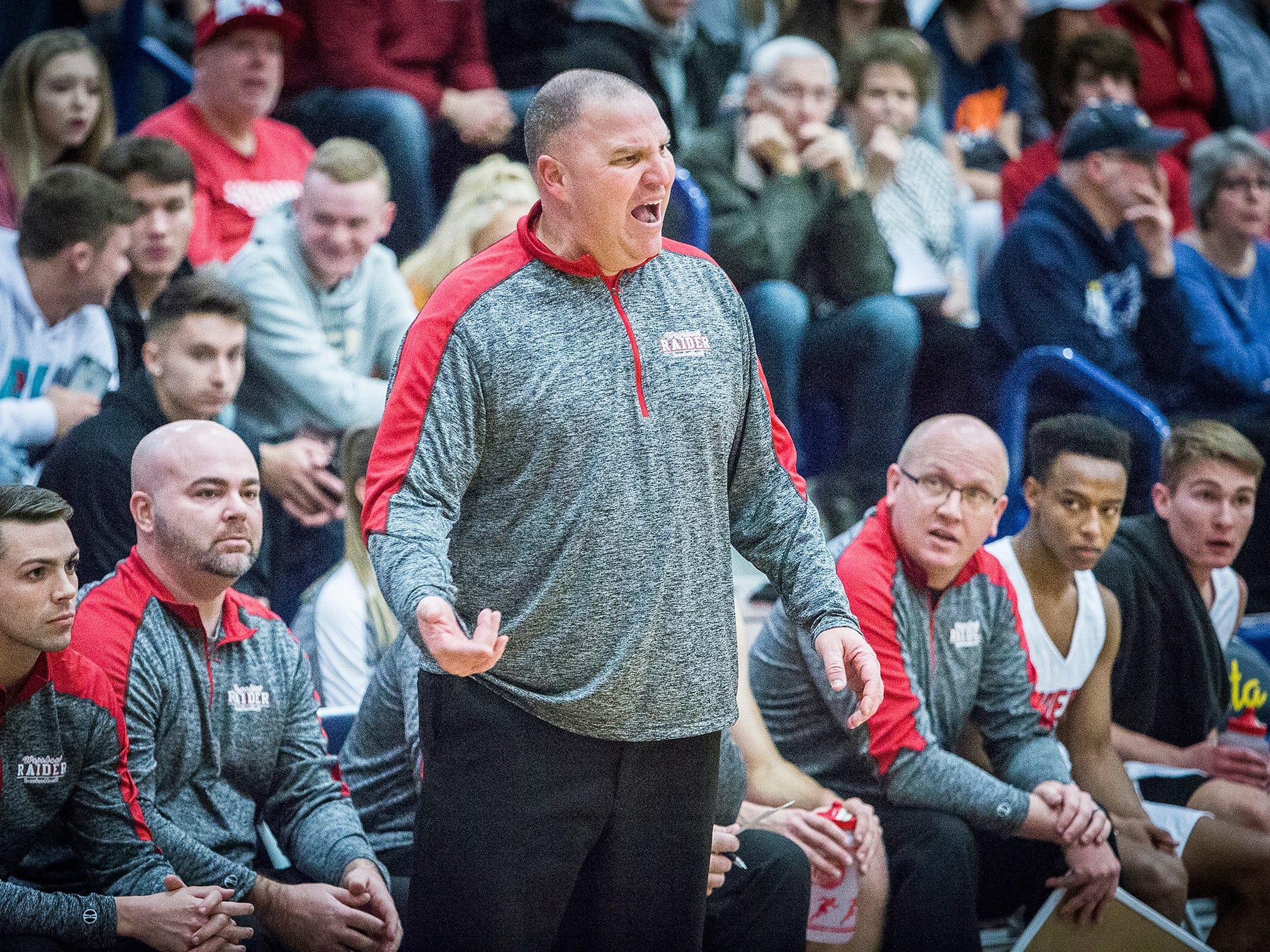 Wapahani's Matt Luce coaches against Delta during the Delaware County Basketball Tournament at Delta High School Tuesday, Jan. 8, 2019.