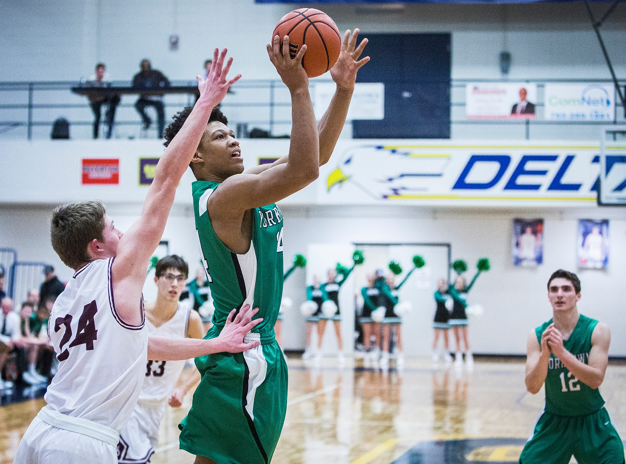 Yorktown's Daiviante Osuna shoots past Wes-Del's defense during the Delaware County Basketball Tournament at Delta High School Tuesday, Jan. 8, 2019.