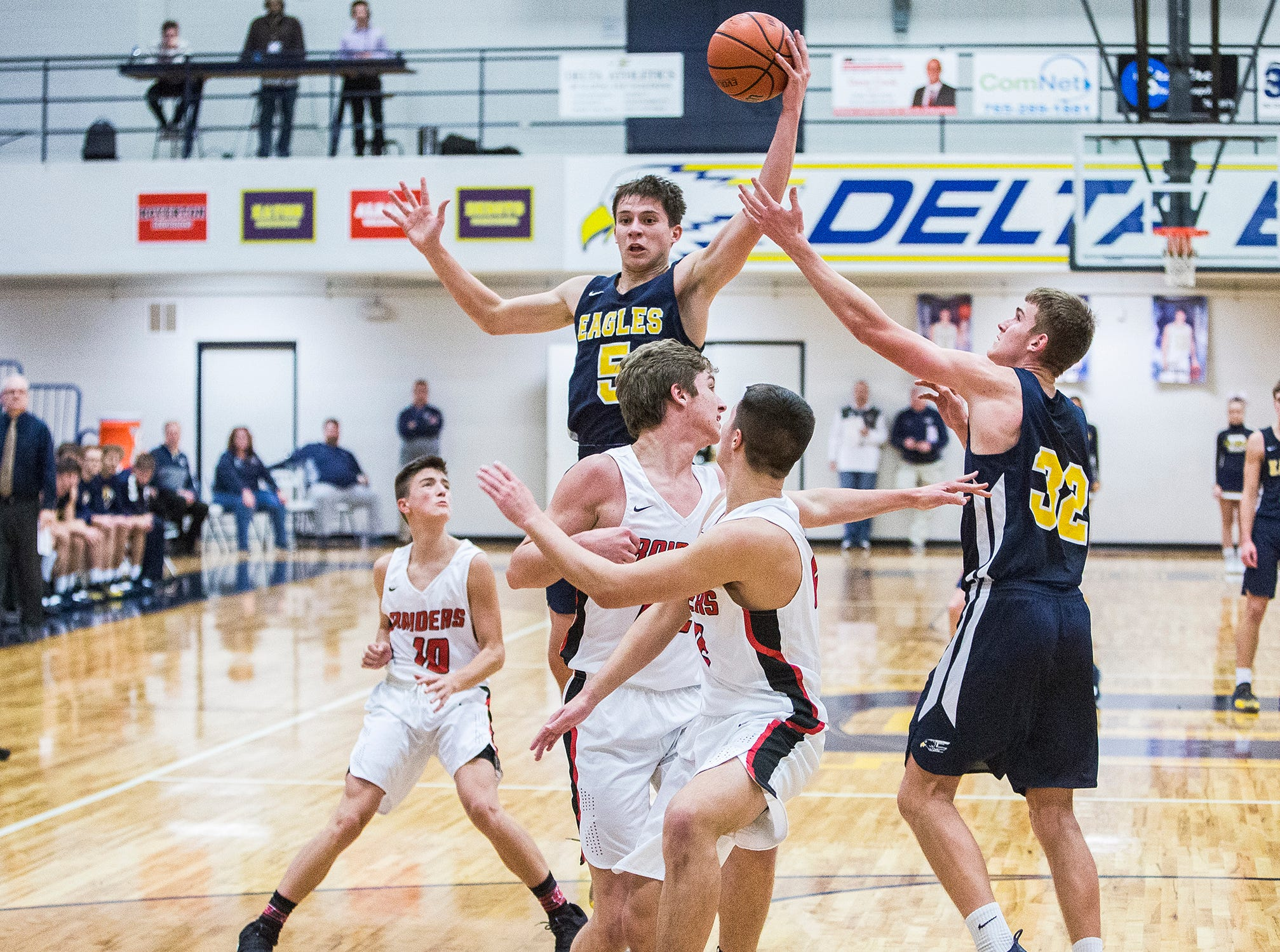 Delta faces off against Wapahani during the Delaware County Basketball Tournament at Delta High School Tuesday, Jan. 8, 2019.