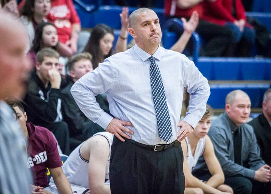 FILE -- Wes-Del's John McGlothin coaches against Yorktown during the Delaware County Basketball Tournament at Delta High School Tuesday, Jan. 8, 2019.