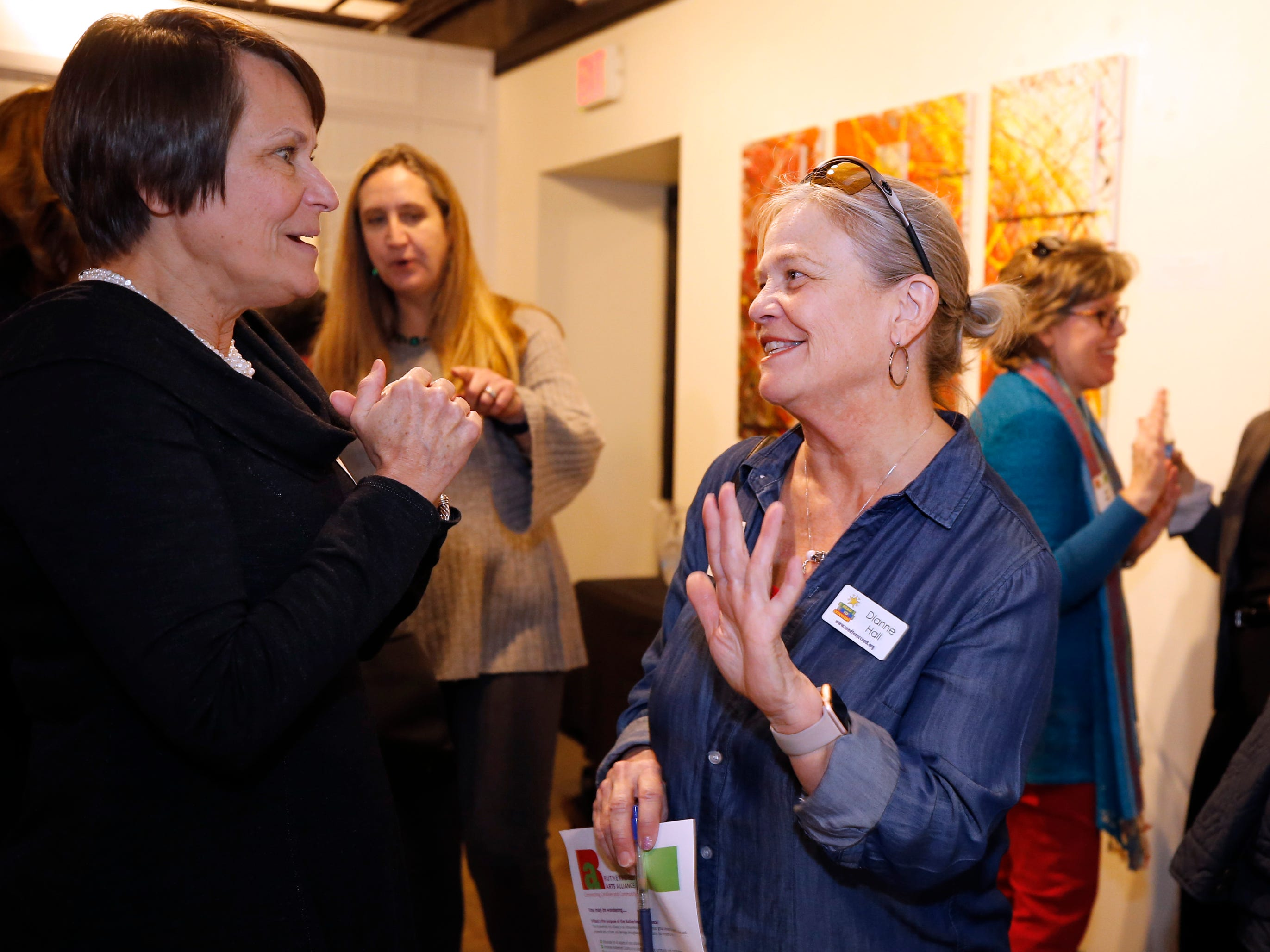 Jennifer Joines left and Dianne Hall at an arts reception for Rutherford Arts Alliance held at the Center for the Arts on Wednesday Jan. 9, 2019.