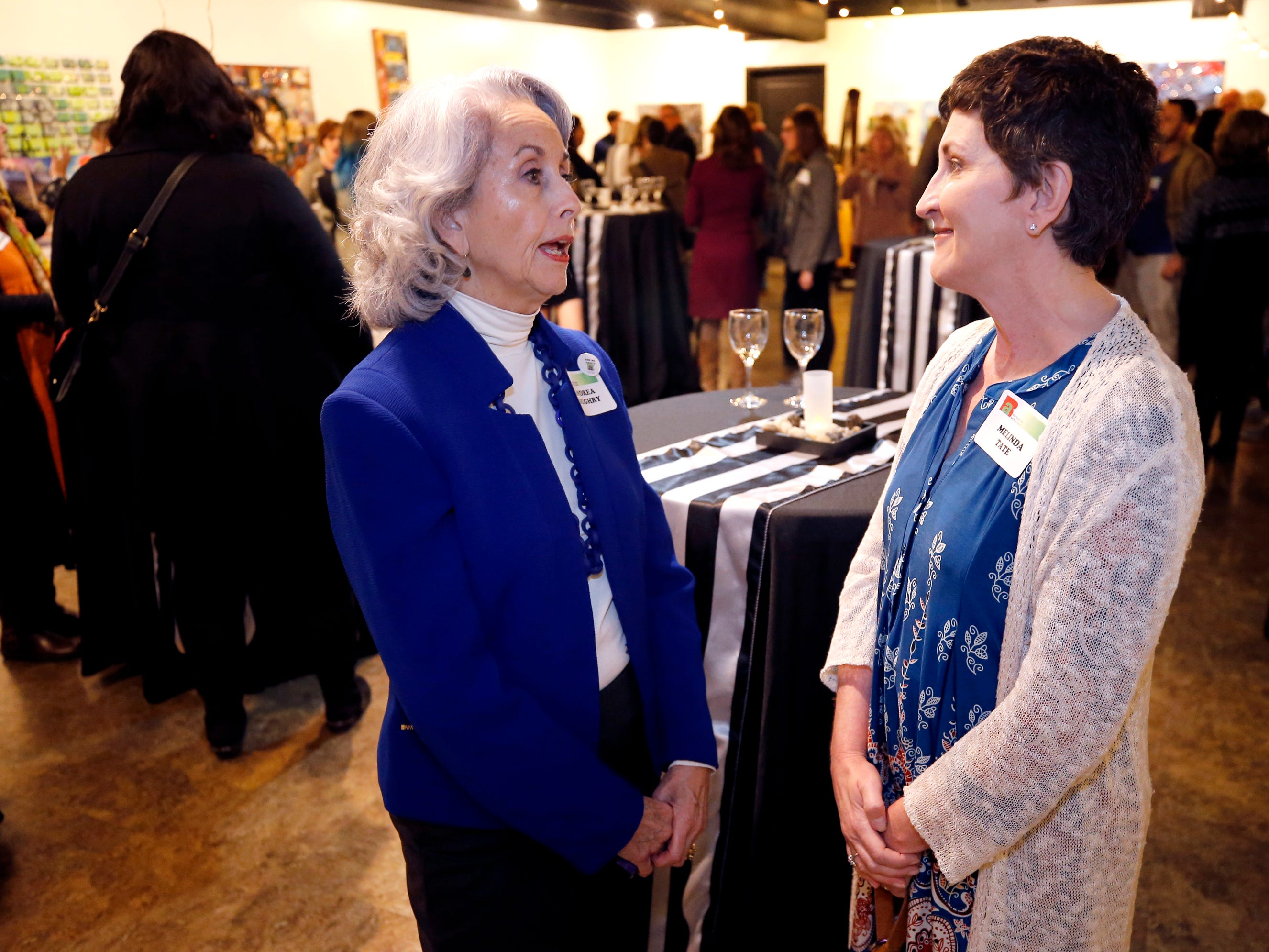 Andrea Loughry, left and Melinda Tate at an arts reception for Rutherford Arts Alliance held at the Center for the Arts on Wednesday Jan. 9, 2019.