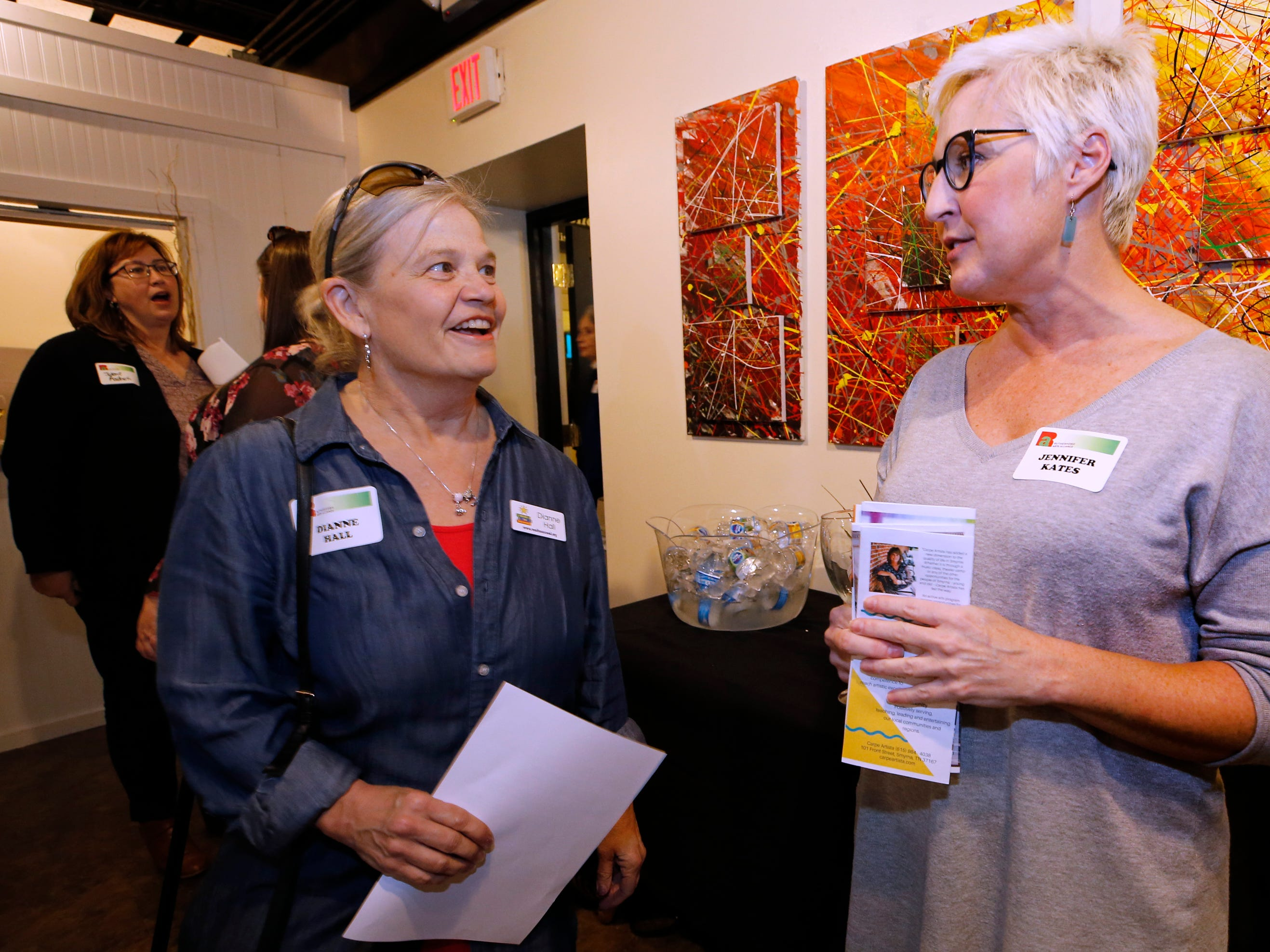 Dianne Hall, left and Jennifer Kates at an arts reception for Rutherford Arts Alliance held at the Center for the Arts on Wednesday Jan. 9, 2019.