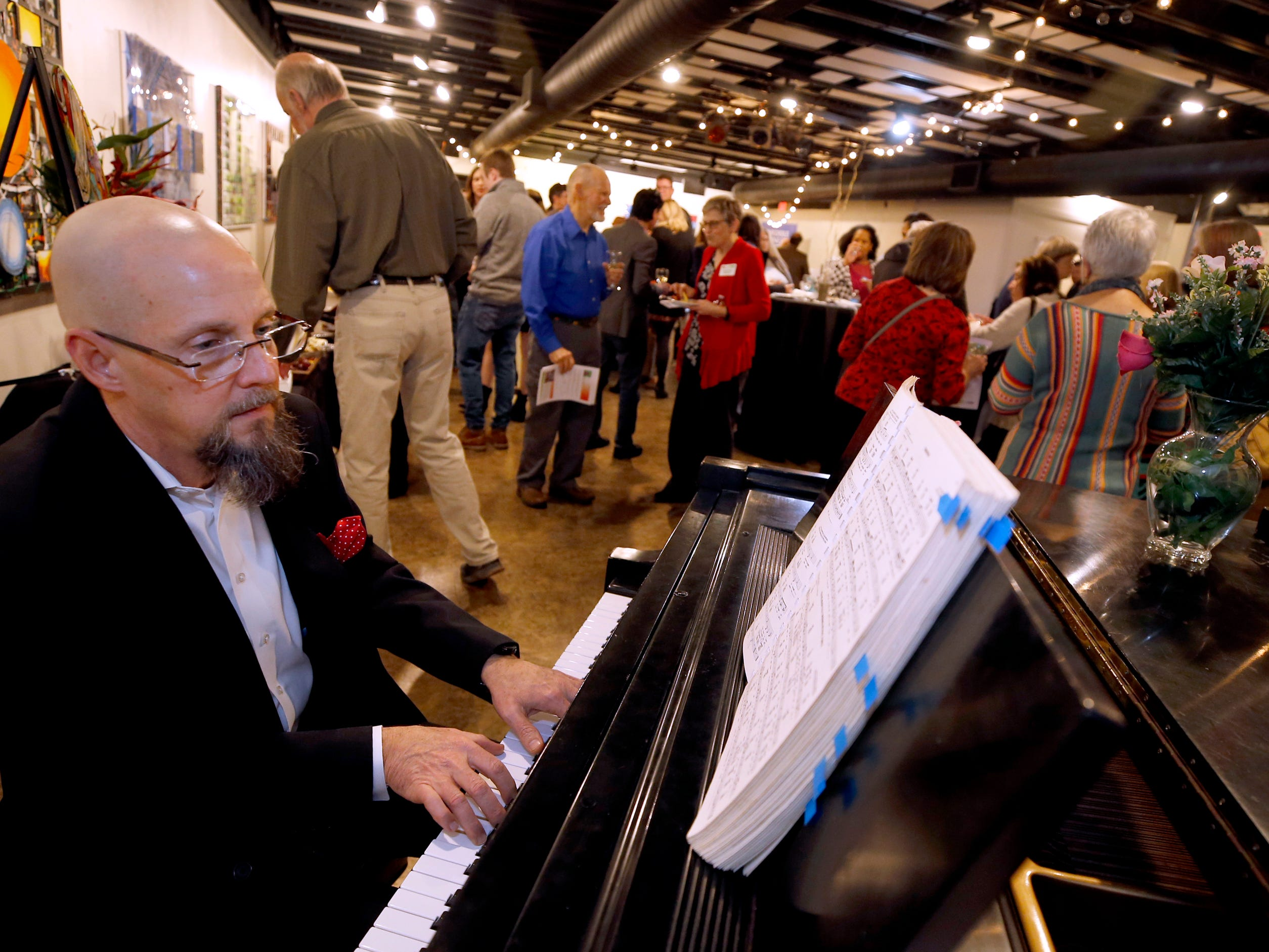 Royce Phillips plays a variety of songs during an arts reception for Rutherford Arts Alliance that was held at the Center for the Arts on Wednesday Jan. 9, 2019.