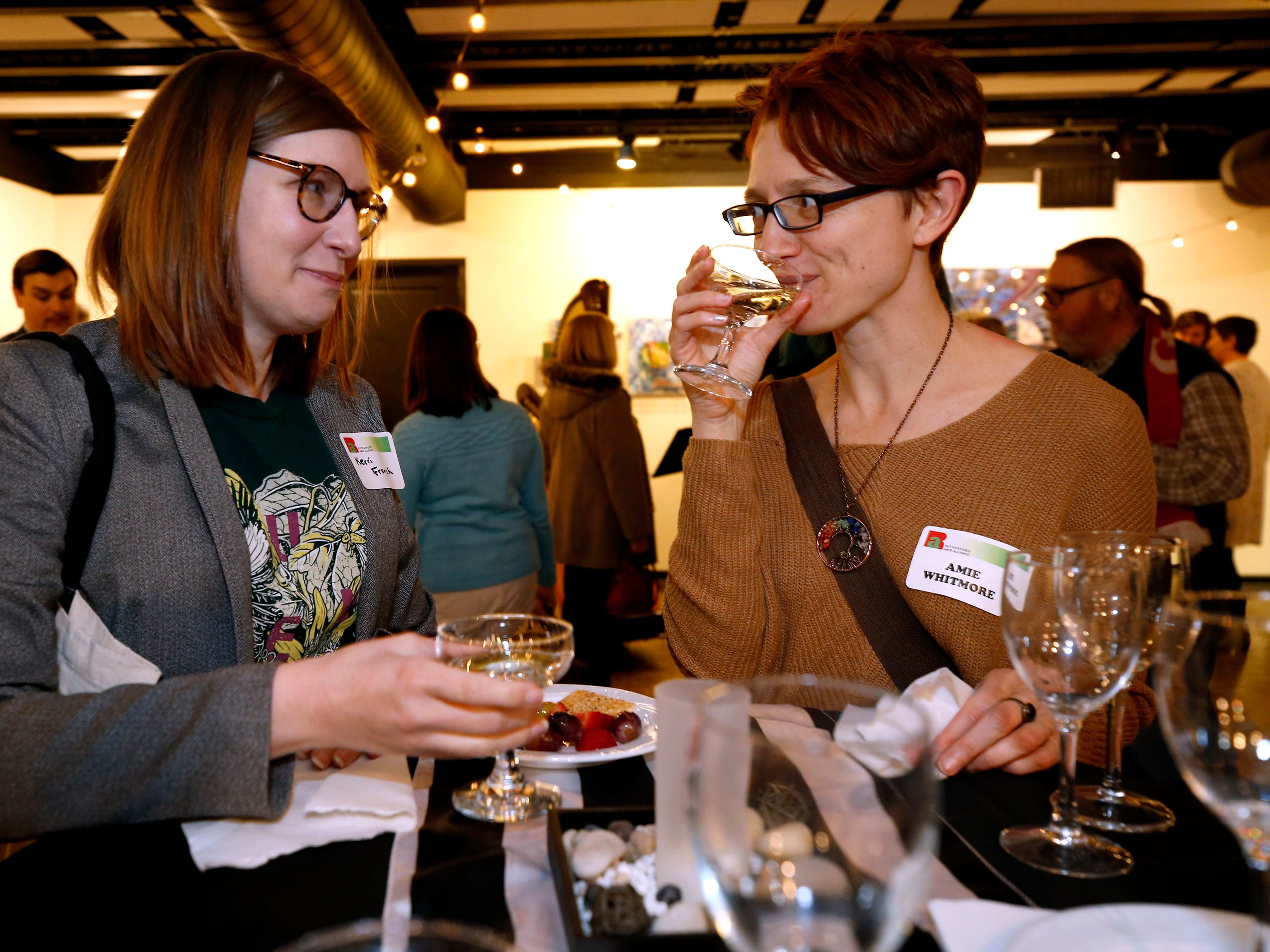 Kerri French, left and Amie Whitmore at an arts reception for Rutherford Arts Alliance held at the Center for the Arts on Wednesday Jan. 9, 2019.
