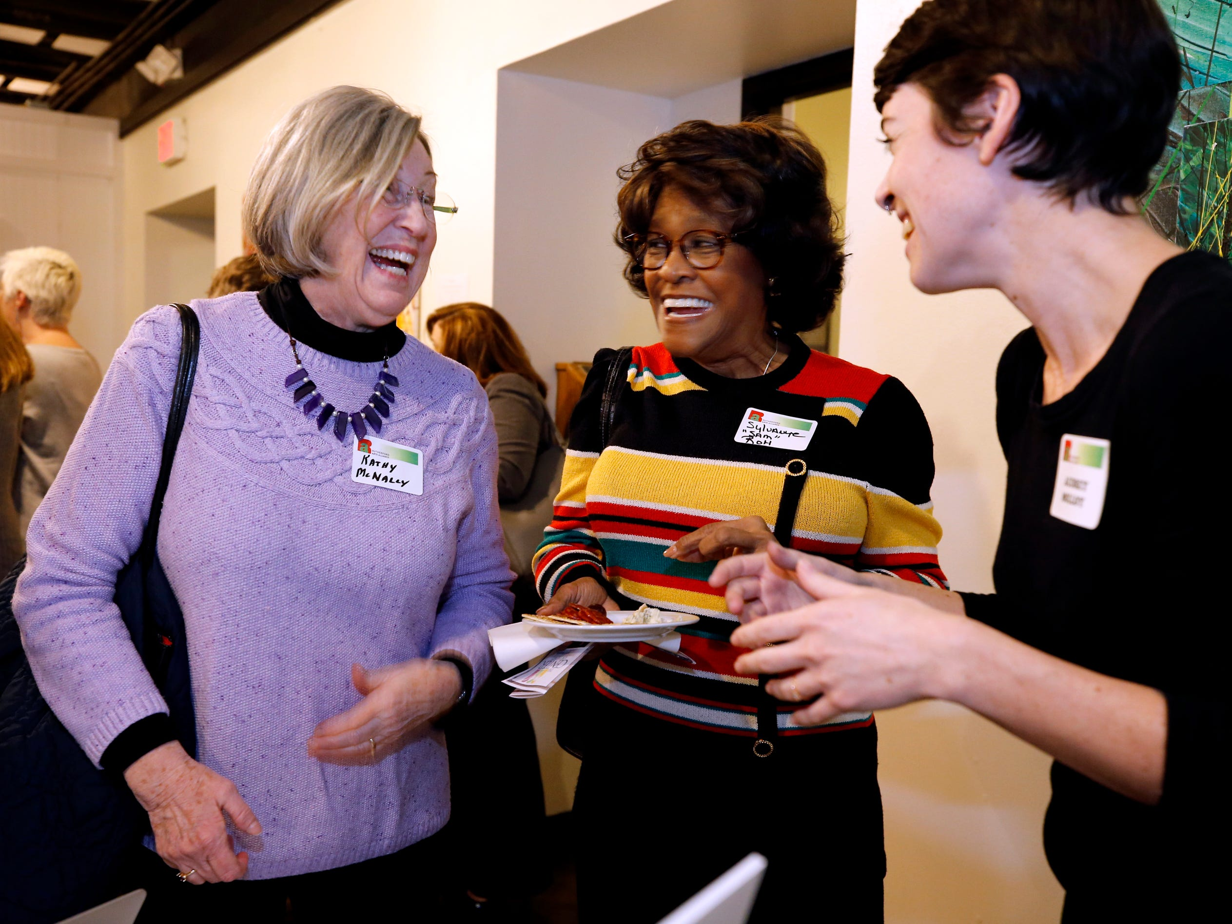 "Kathy McNally, left, Sylanhye ""Sam""  Roh , center and Audrey Molly , right share a laugh at an arts reception for Rutherford Arts Alliance which was held at the Center for the Arts on Wednesday Jan. 9, 2019."