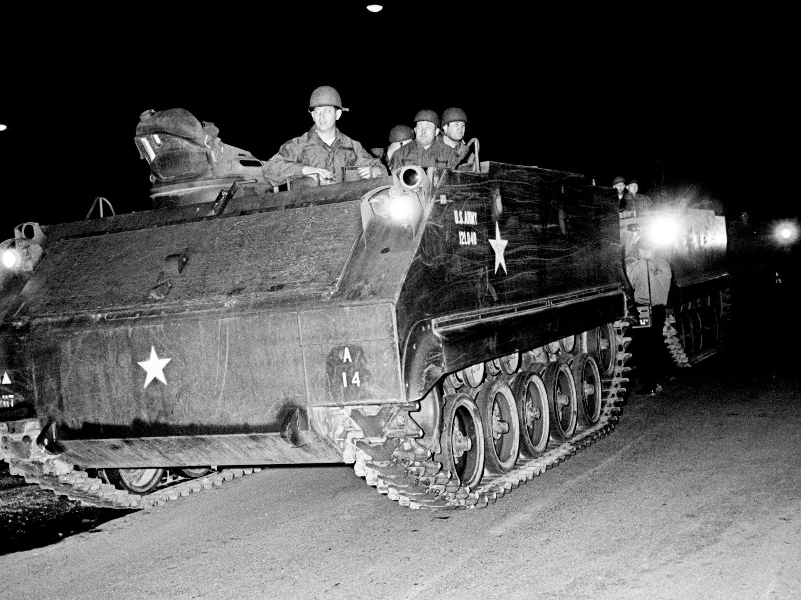 The armored personnel carriers of the Tennessee National Guard move in to seal off North Nashville after midnight April 5, 1968. The troops were called at the request of Metro Mayor Beverly Briley after rock throwing began about 8 p.m. and escalated into gunfire and scattered looting after the assassination of the Rev. Martin Luther King Jr. in Memphis.