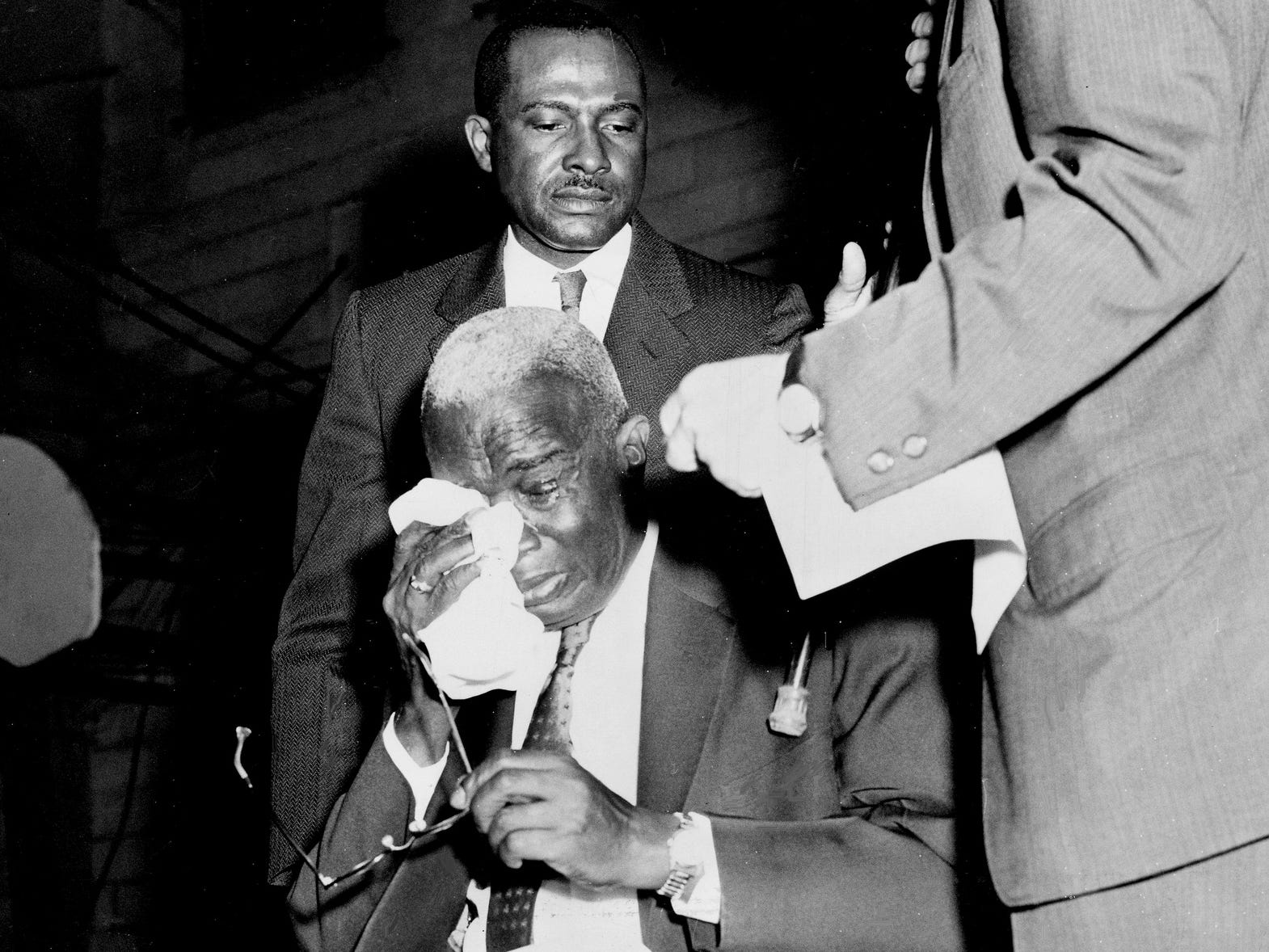 Nashville City Councilman Z. Alexander Looby, his home bombed the night before, collapses weeping in a chair as he receives a prolonged ovation April 20, 1960, from the crowd at a rally that included Dr. Martin Luther King Jr. Standing behind Looby is the Rev. Andrew White.
