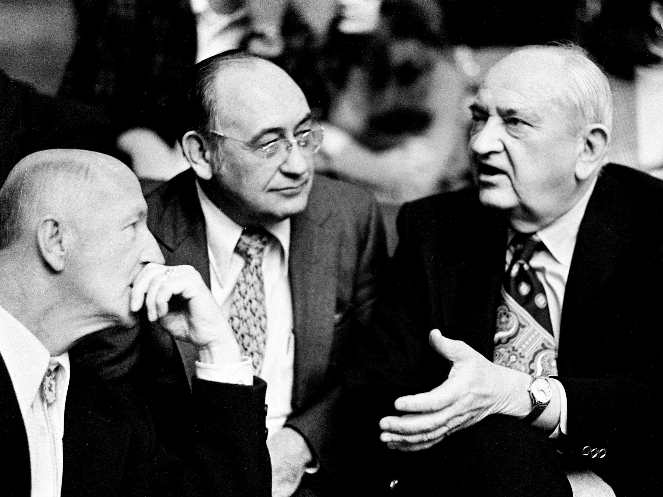 Retire Kentucky coach Adolph Rupp, right, talks with Scoop Hudgins, center, and another before the start of the Wildcats championship game against Indiana. The Indiana Hoosiers defeated the Kentucky Wildcats 72-65 to win the Mideast Regional championship before 16,000 at Memorial Gym March 17, 1973.