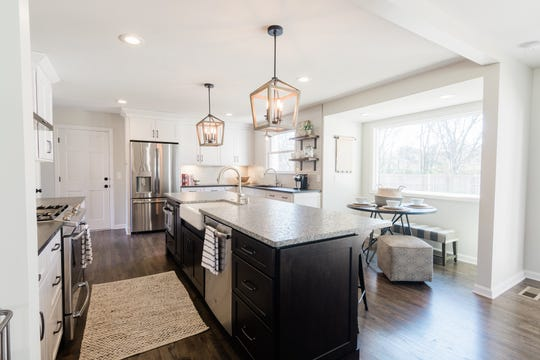 AFTER: The kitchen at 405 Oakvale was completely re-imagined by Design Hive and now features two sinks, a large island, new appliances and is open to the home's living space thanks to the removal of a wall.