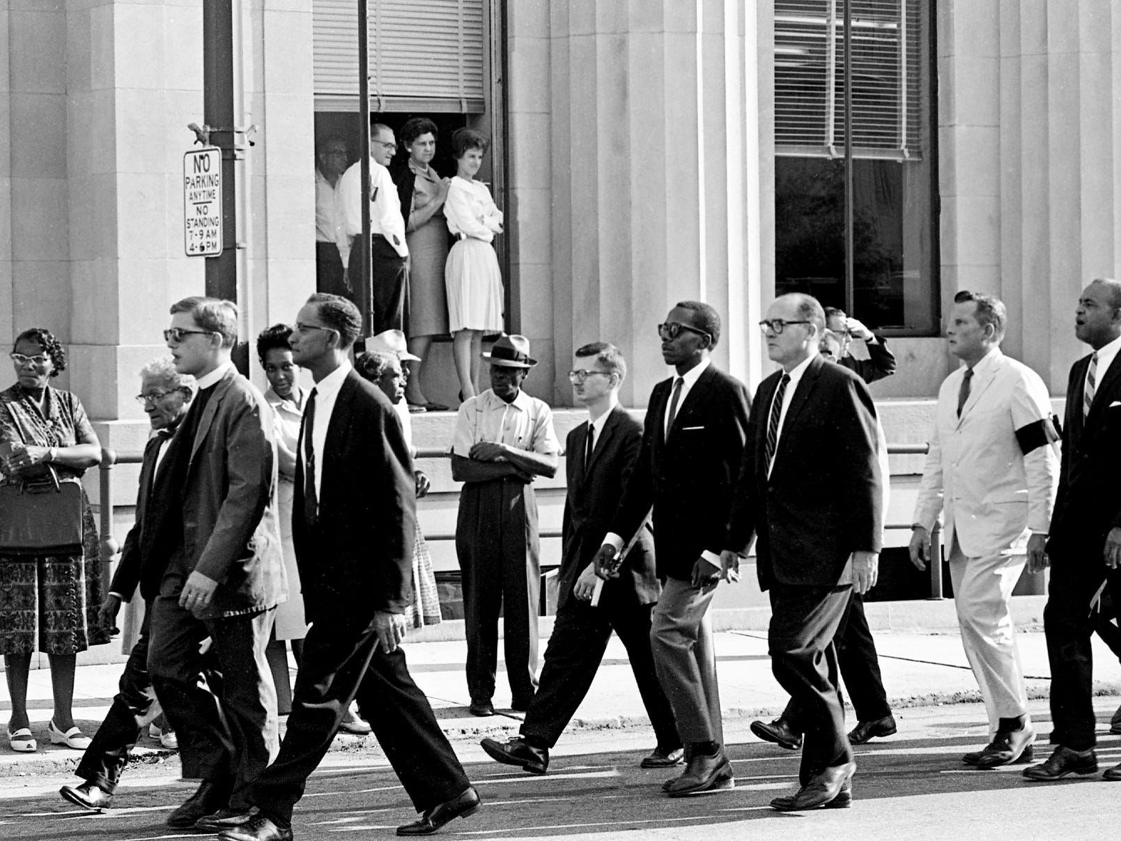 About 150 people march silently from Watkins Park to the steps of the state Capitol on Sept. 18, 1963, as a gesture of sympathy for the families of the four girls killed in the Birmingham, Ala., church bombing. The march, sponsored by the Nashville branch of the NAACP, took place during the funeral services in Birmingham for three of the four victims.