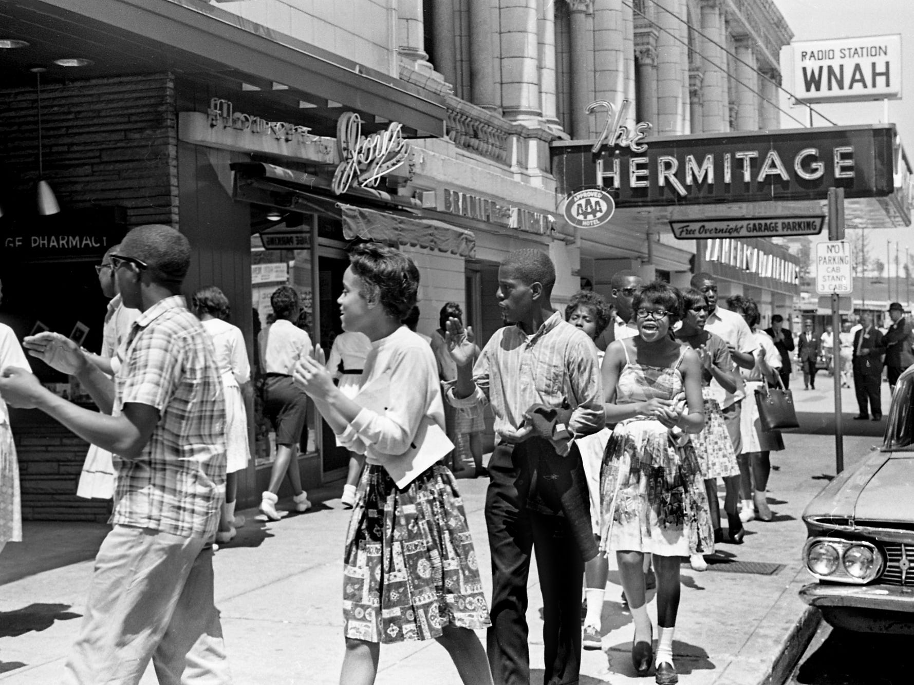 "Black high school students join 600 demonstrators in downtown Nashville to demonstrate at restaurants, department stores and the Metro Courthouse on May 8, 1963. Principals of two black high schools said the students' absences would be recorded as ""unexcused."""