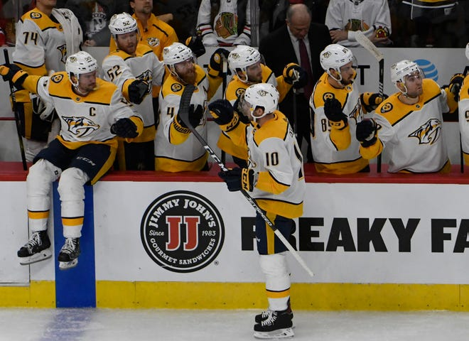 Jan 9, 2019; Chicago, IL, USA; Nashville Predators center Colton Sissons (10) celebrates his goal against the Chicago Blackhawks with his teammates during the first period  at United Center. Mandatory Credit: David Banks-USA TODAY Sports