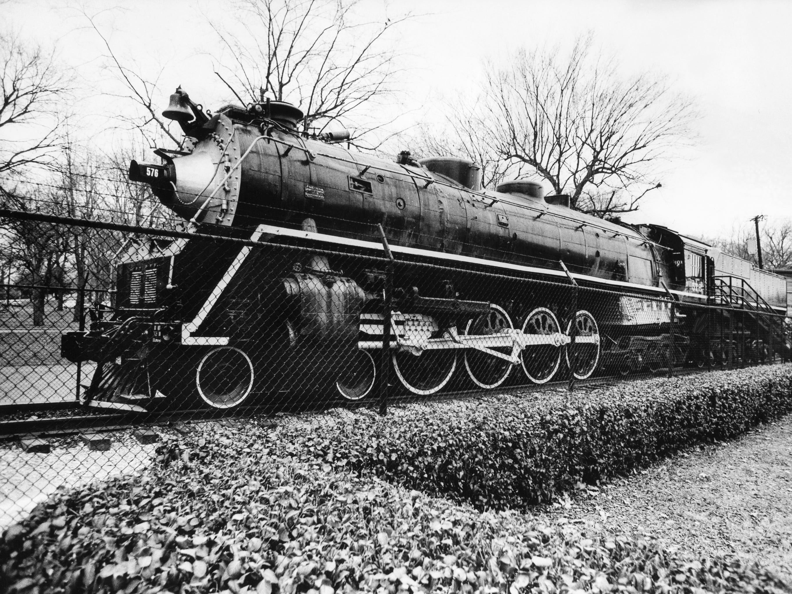 Steam locomotive No. 576, here Dec. 27, 1980, may no longer roll along the tracks, but it can still catch the interests of children, young and old, who come to see the sights of Centennial Park.