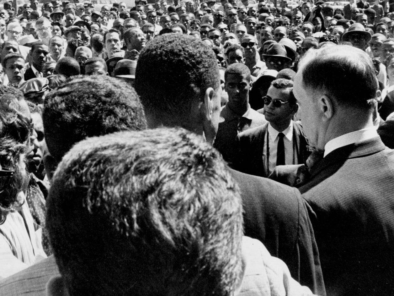 Nashville Mayor Ben West, second from right, tells a crowd of black demonstrators April 19, 1960, that he intends to uphold the law but that he also feels lunch counter segregation is unjust. The Rev. C.T. Vivian, at West's left, read a statement critical of the mayor and then debated with West.