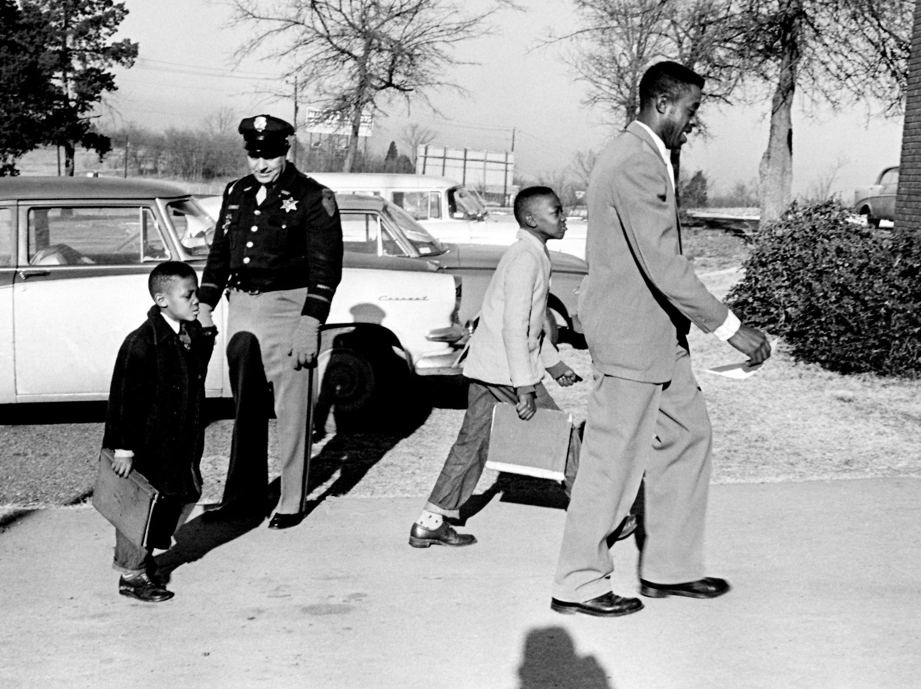 Under the watchful eyes of the Davidson County sheriff, a father leads his two sons into Mt. View Elementary School during the first day of desegregation of the formerly all-white county school Jan. 23, 1961. Thirty-nine black children enrolled in 10 formerly all-white Davidson County schools. There was no disturbance as the county desegregated the first four grades in accordance with a plan approved by Federal Judge William E. Miller.