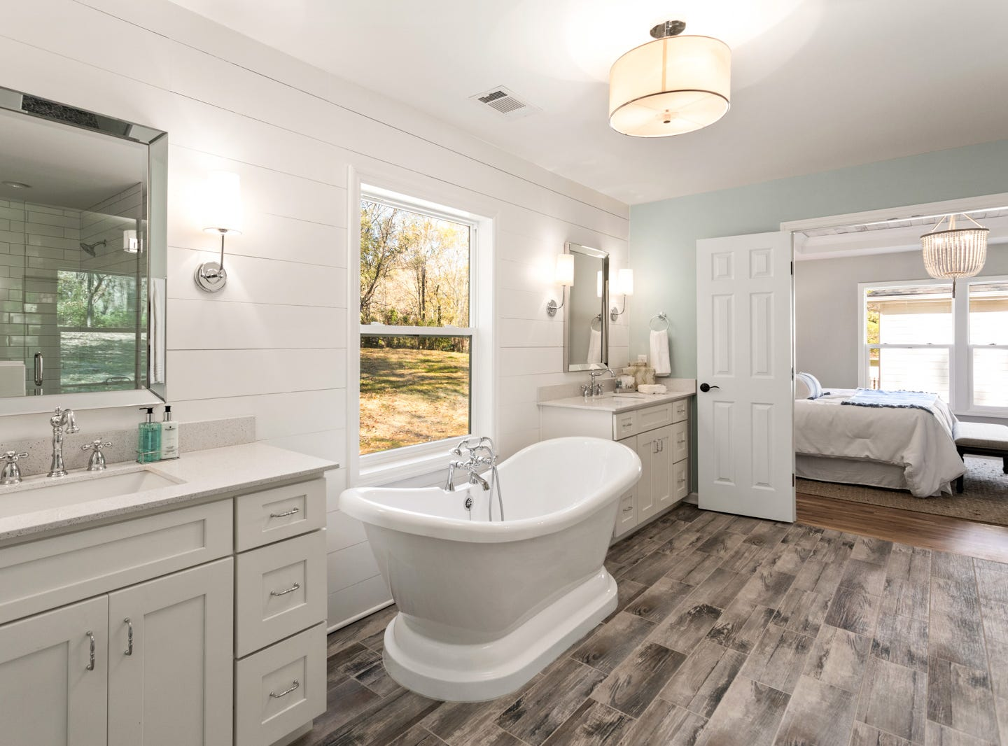 AFTER: The master bath in this home was completely re-imagined to give the next owners plenty of space. Many master bathrooms in these original homes from the 1970s did not have large bathrooms connected to a master suite.