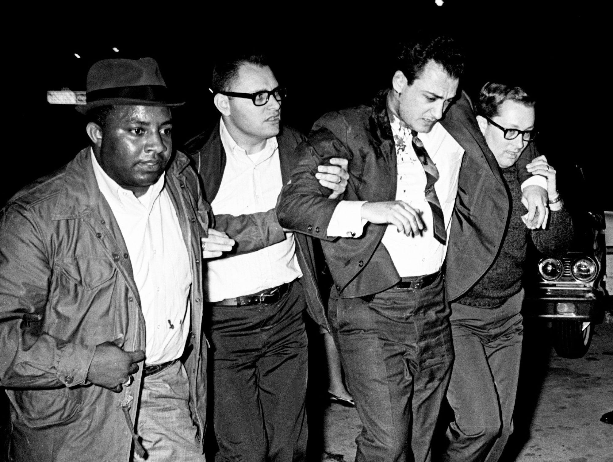 Metro Assistant Police Chief John Sorace, second from right, is helped into Saint Thomas Hospital's emergency room after an unmarked police car in which he was riding was bombarded by rocks from rioters on Centennial Boulevard on April 4, 1968.
