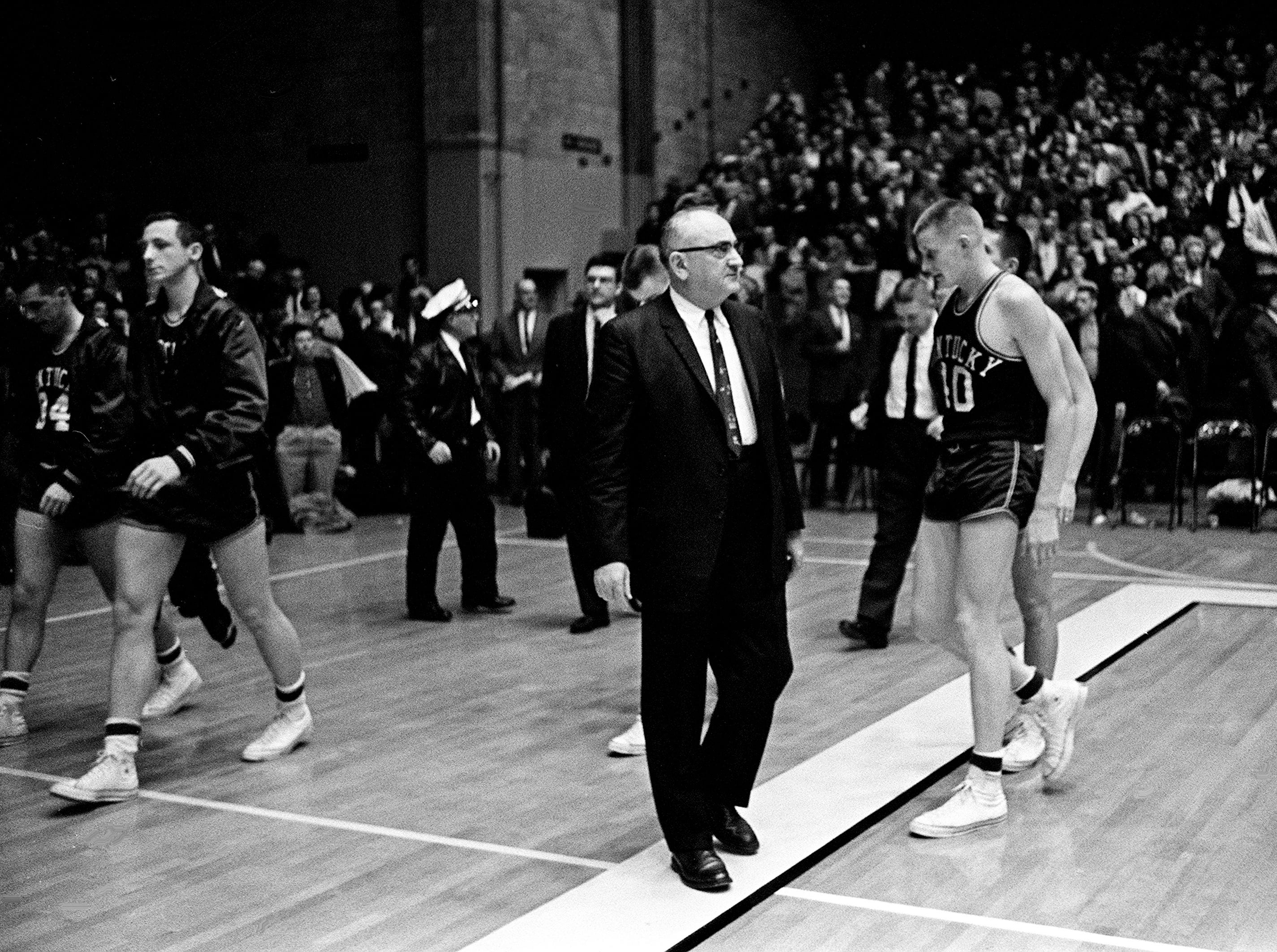 An unhappy Kentucky head coach Adolph Rupp and his players walks off the court after been defeated by Vanderbilt Jan. 9, 1961. The Wildcats became the Commodores' 11th straight victim, falling 64-62 before 7,324 fans at Memorial Gym.