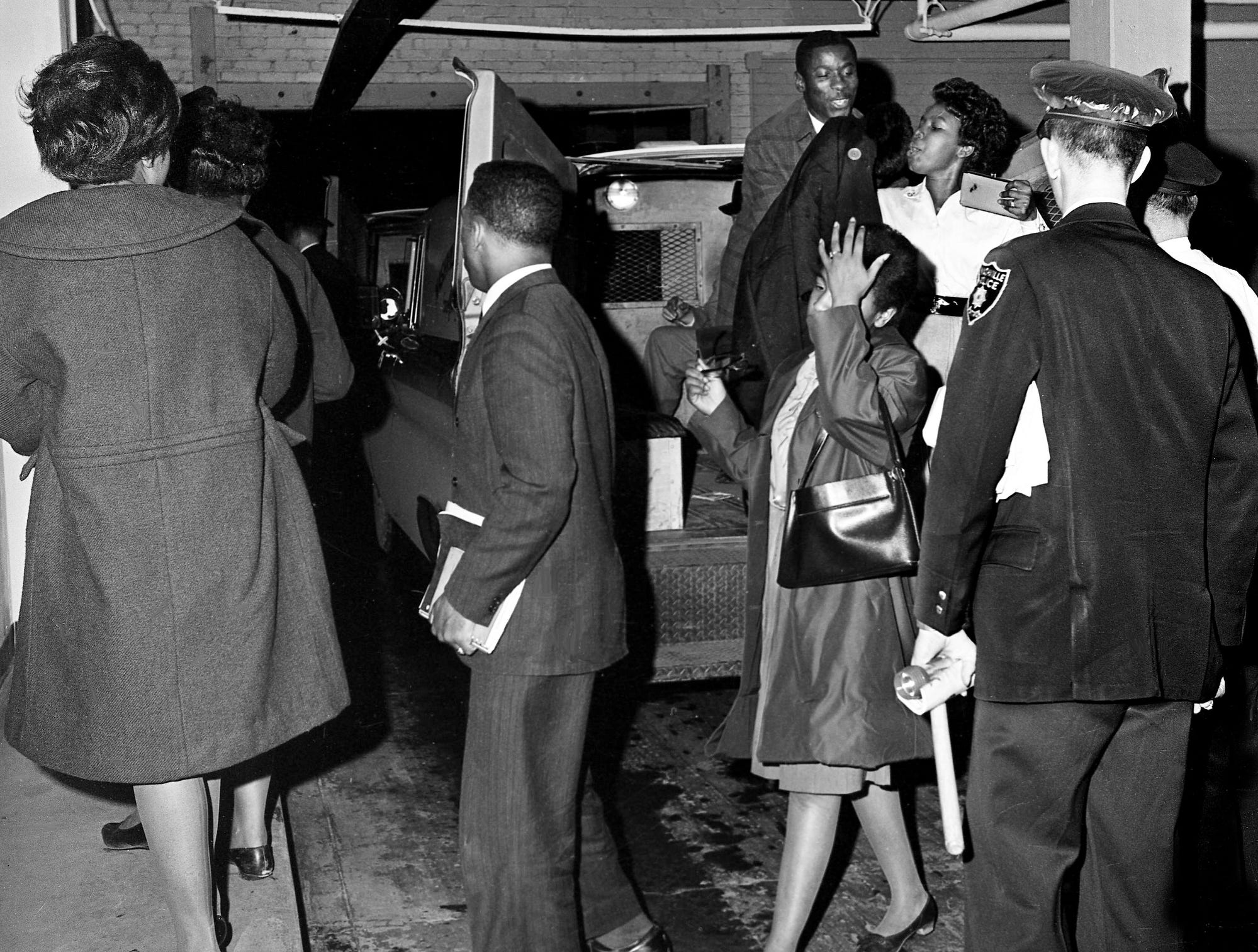 Black demonstrators sing hymns as they unload from a Nashville police van after their arrest March 4, 1963, when the group staged a large-scale sit-in at the segregated Cross Keys Restaurant in downtown Nashville. It was the largest assault on downtown Nashville segregation since 1960. The group gained entrance to the restaurant, and officers arrested and dragged the demonstrators out after their orders to leave were refused.