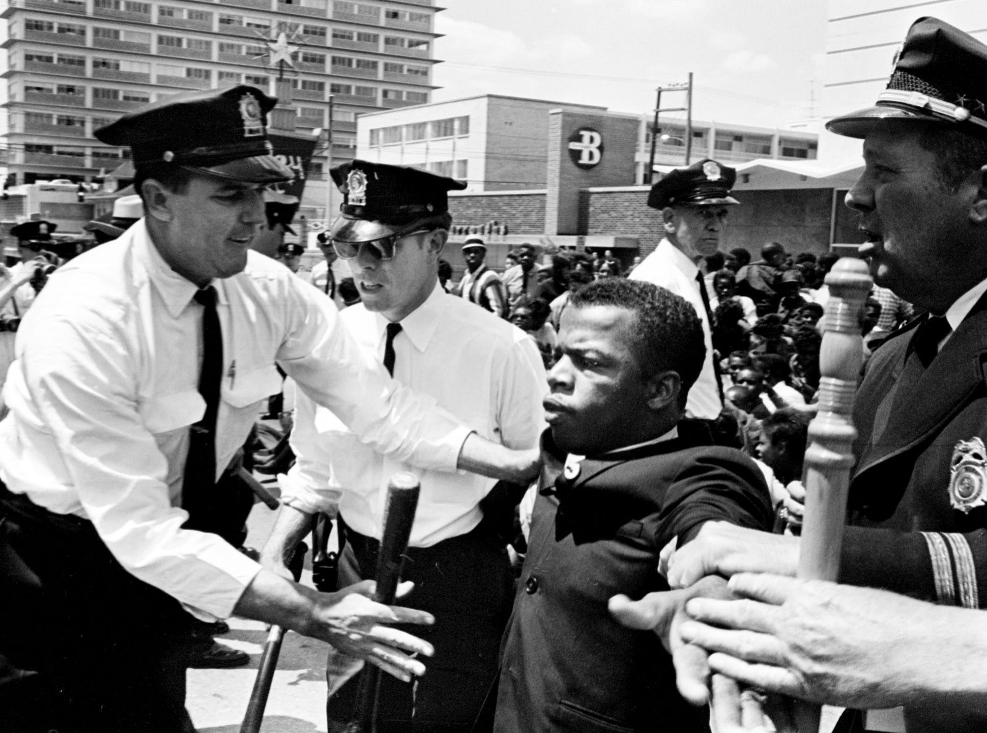 Metro police officers grab John Lewis, one of the leaders of the civil rights demonstrators, at Morrison's Cafeteria on West End Avenue on April 29, 1964.